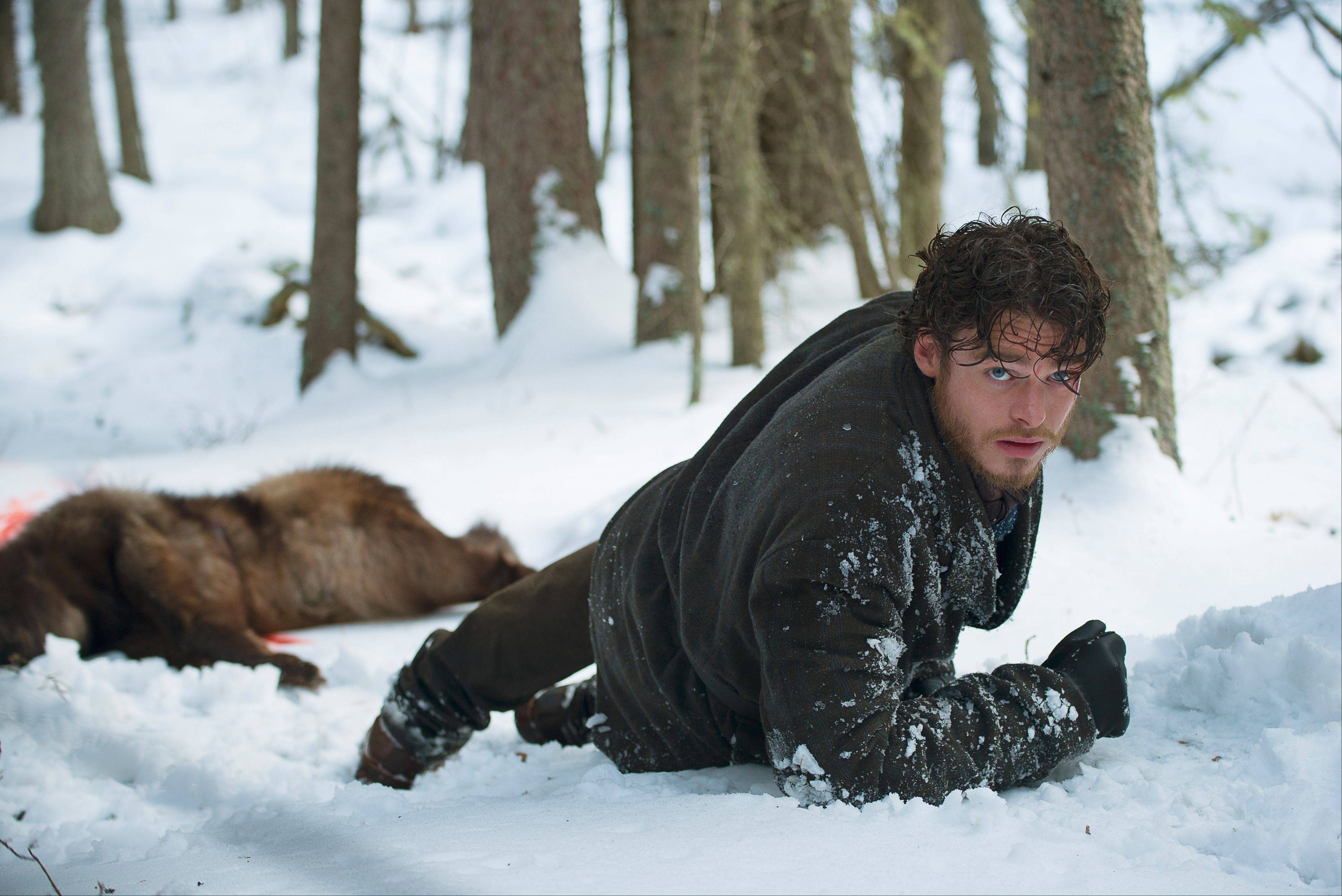 "Bill Haskell (Richard Madden) braves the elements in search of gold in Discovery Channel's ""Klondike."""