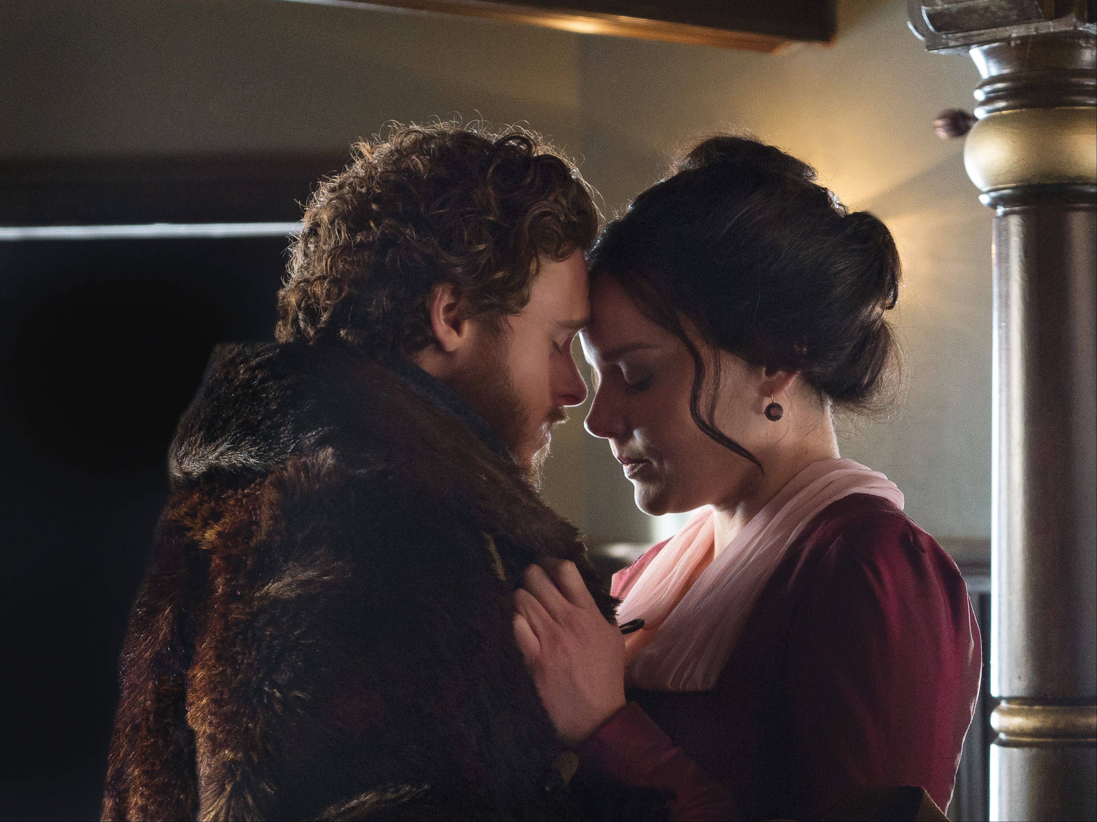 "Bill Haskell (Richard Madden), left, and Belinda Mulrooney (Abbie Cornish) share a tender moment amid their struggles in Discovery's Channel's ""Klondike."""