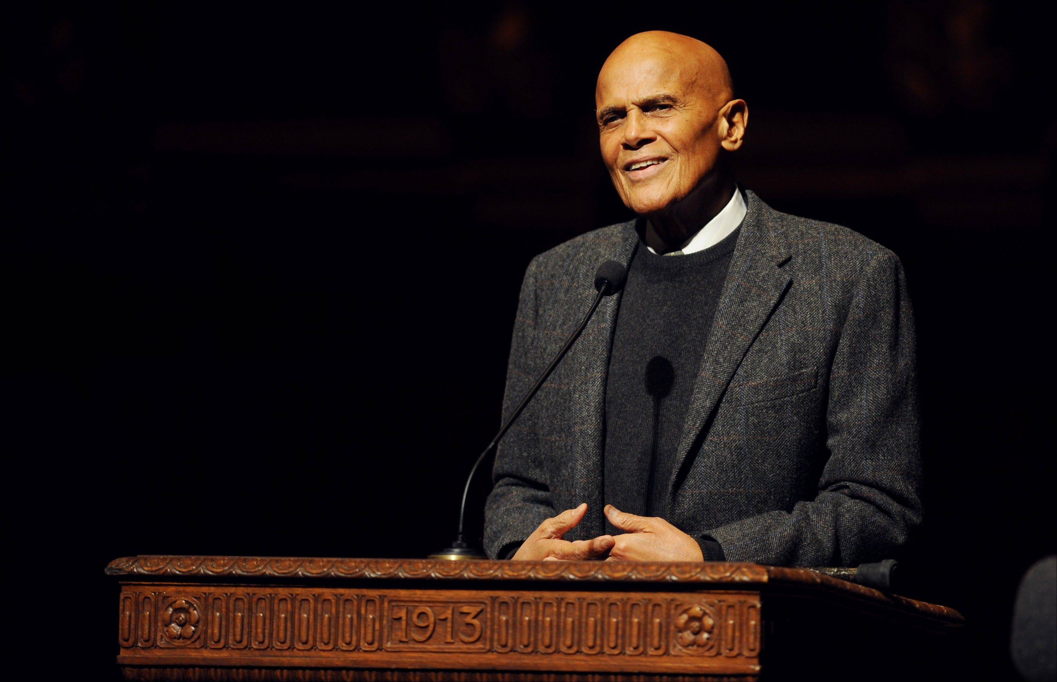 Activist and entertainer Harry Belafonte gives the keynote address for the Rev. Dr. Martin Luther King Jr. Symposium at Hill Auditorium on the University of Michigan campus in Ann Arbor, Mich., for Martin Luther King Jr. Day, on Monday, Jan. 20, 2014.
