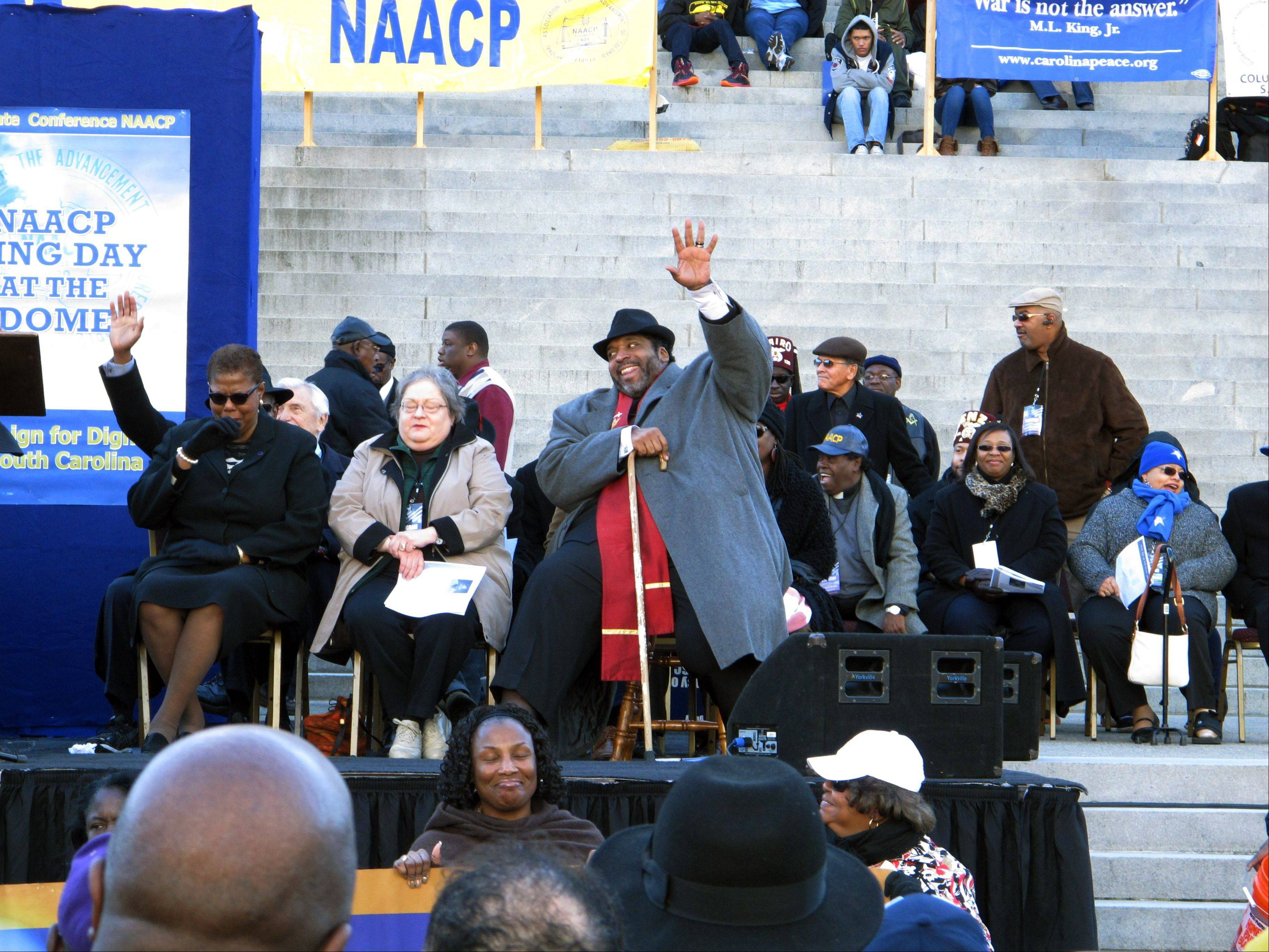 North Carolina NAACP President William Barber waves to the crowd as he waits to speak at the King Day celebration on Monday, Jan. 20, 2014, in Columbia, S.C. Barber was invited to speak about social justice.