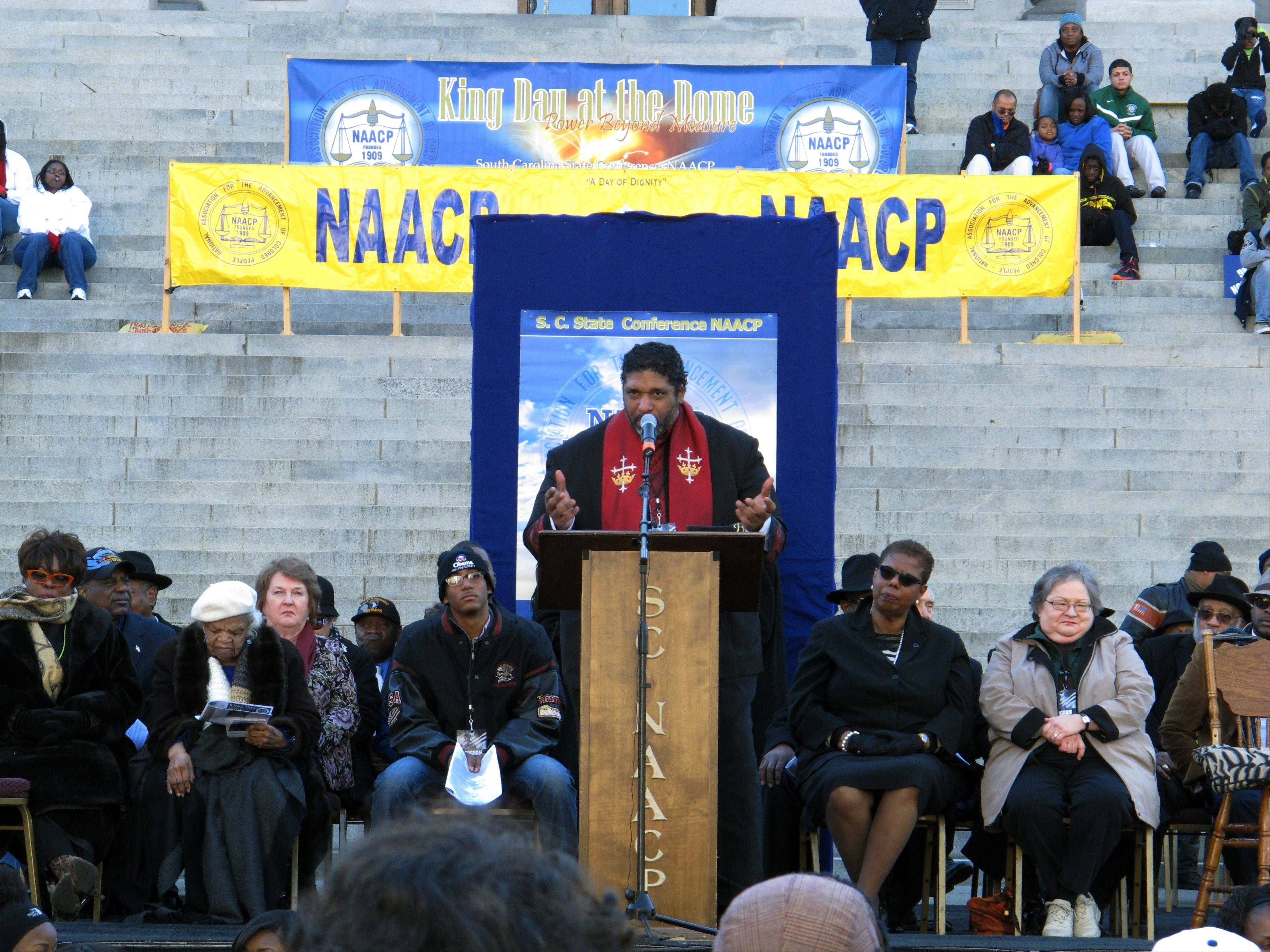 North Carolina NAACP President William Barber talks about fighting for social justice at the King Day rally on Monday, Jan. 20, 2014, in Columbia, S.C. Barber told the crowd of a few thousand people that what conservatives leaders have done to the country is mighty low, but he thinks they are ready to find higher ground.