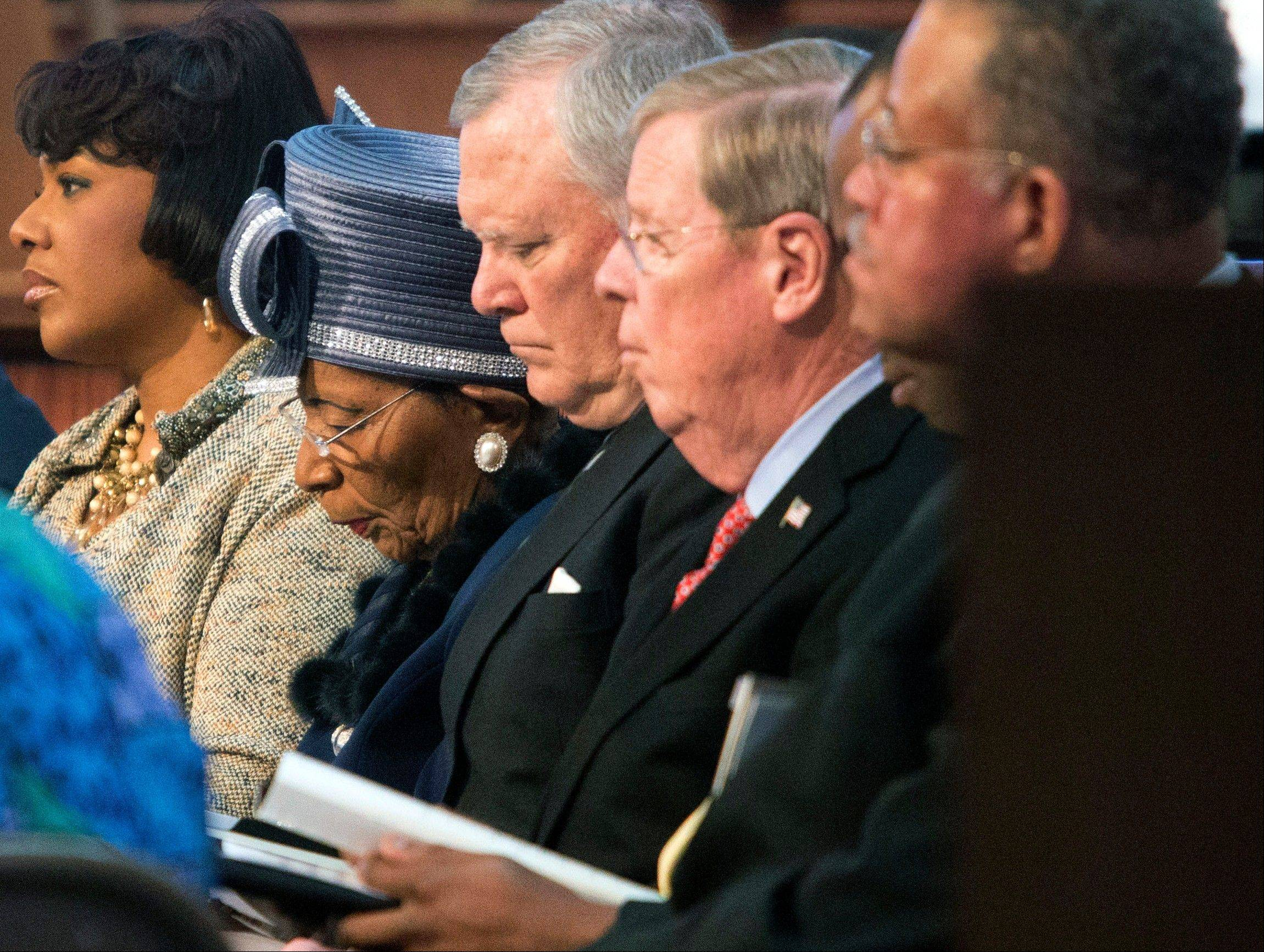 Bernice King, left, Christine King Farris, second from left, Gov. Nathan Deal, third from left, and U.S. Sen. Johnny Isakson, second from right, are shown before the Rev. Martin Luther King Jr. holiday commemorative service at Ebenezer Baptist Church Monday, Jan. 20, 2014, in Atlanta.
