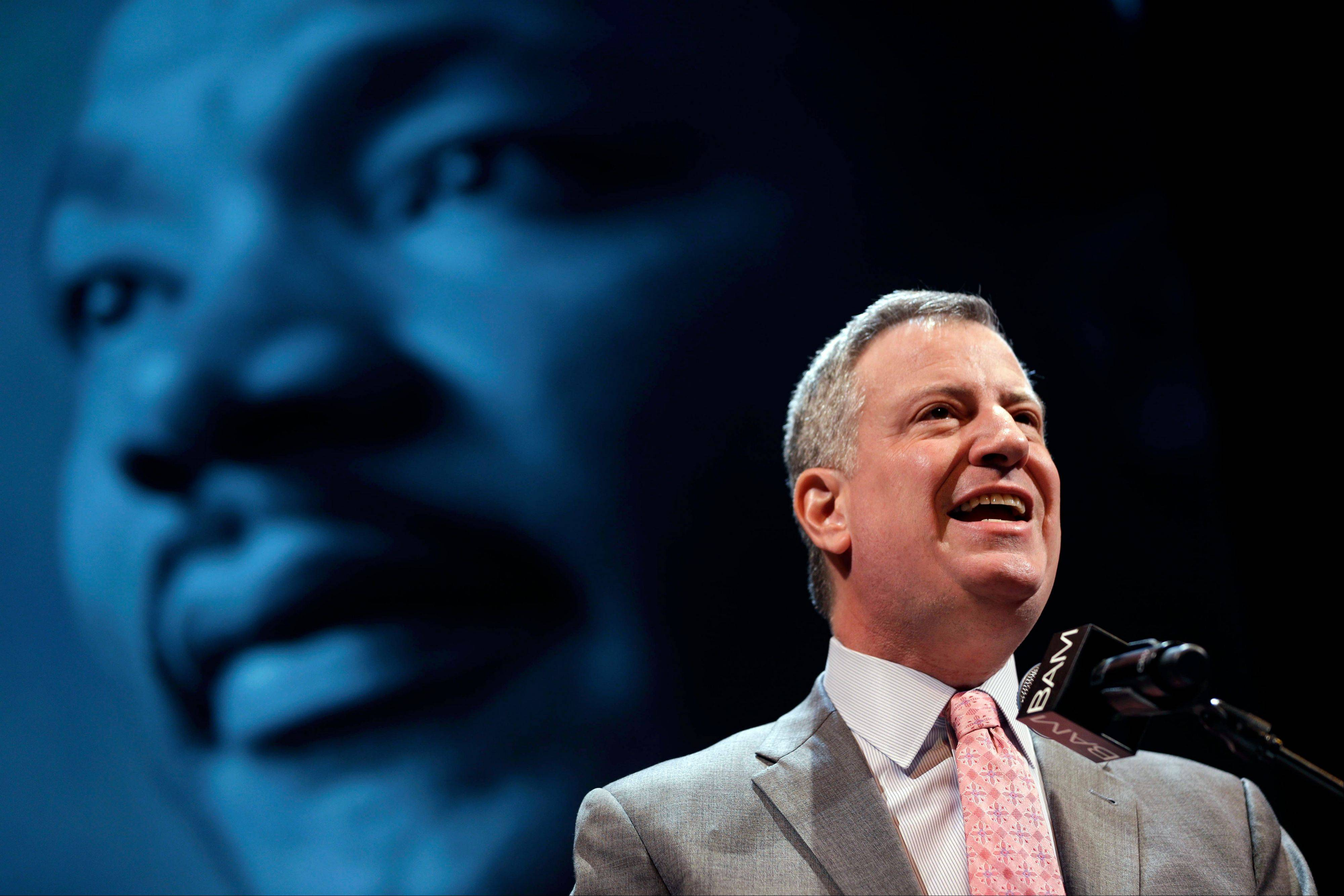 "New York City Mayor Bill de Blasio speaks at a tribute to Martin Luther King, Jr. in the Brooklyn borough of New York, Monday, Jan. 20, 2014. De Blasio told a packed audience Monday at the Brooklyn Academy of Music that the ""price of inequality has deepened."" The mayor says economic inequality is closing doors for hard-working people in the city and around the country."