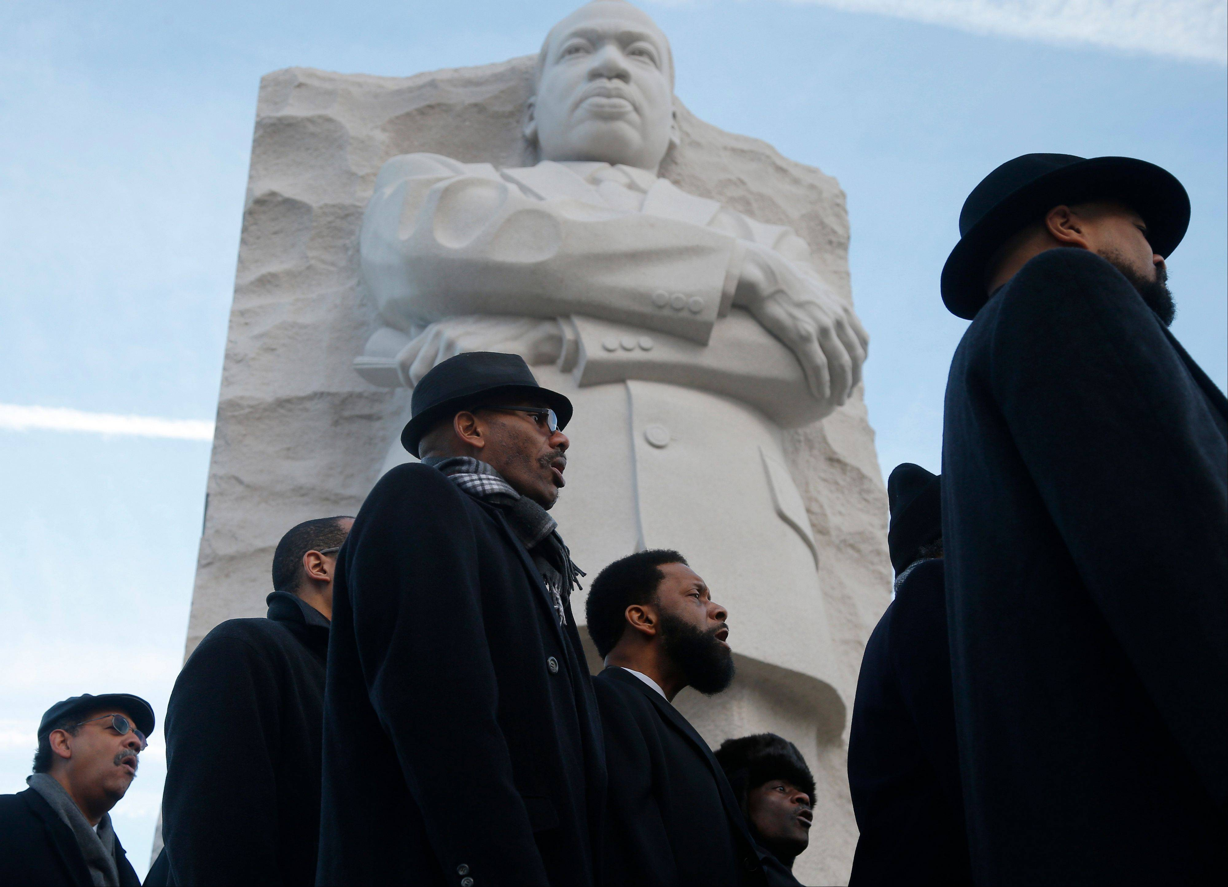 The men's choir from the People's Community Baptist Church in Silver Spring, Md., sing at the Martin Luther King Jr. Memorial in Washington, Monday, Jan. 20, 2014. The nation paused to remember Martin Luther King Jr. Monday with parades, marches and service projects. King was born Jan. 15, 1929, and the federal holiday is the third Monday in January.