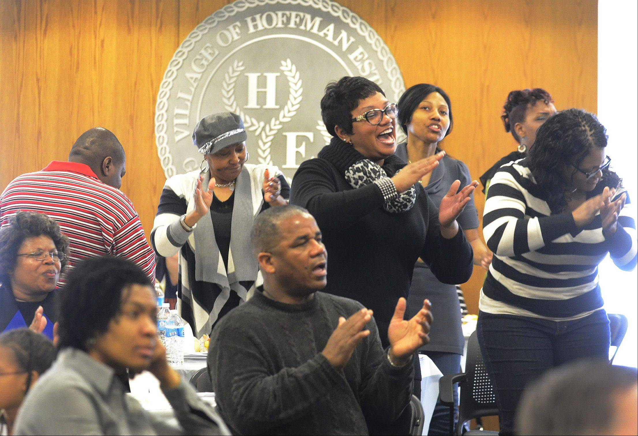 Audience members clap and dance along to the music of the Sears Holdings Associate Gospel Choir on Monday during the Hoffman Estates Cultural Awareness Commission's 12th annual Martin Luther King Jr. Community Breakfast.