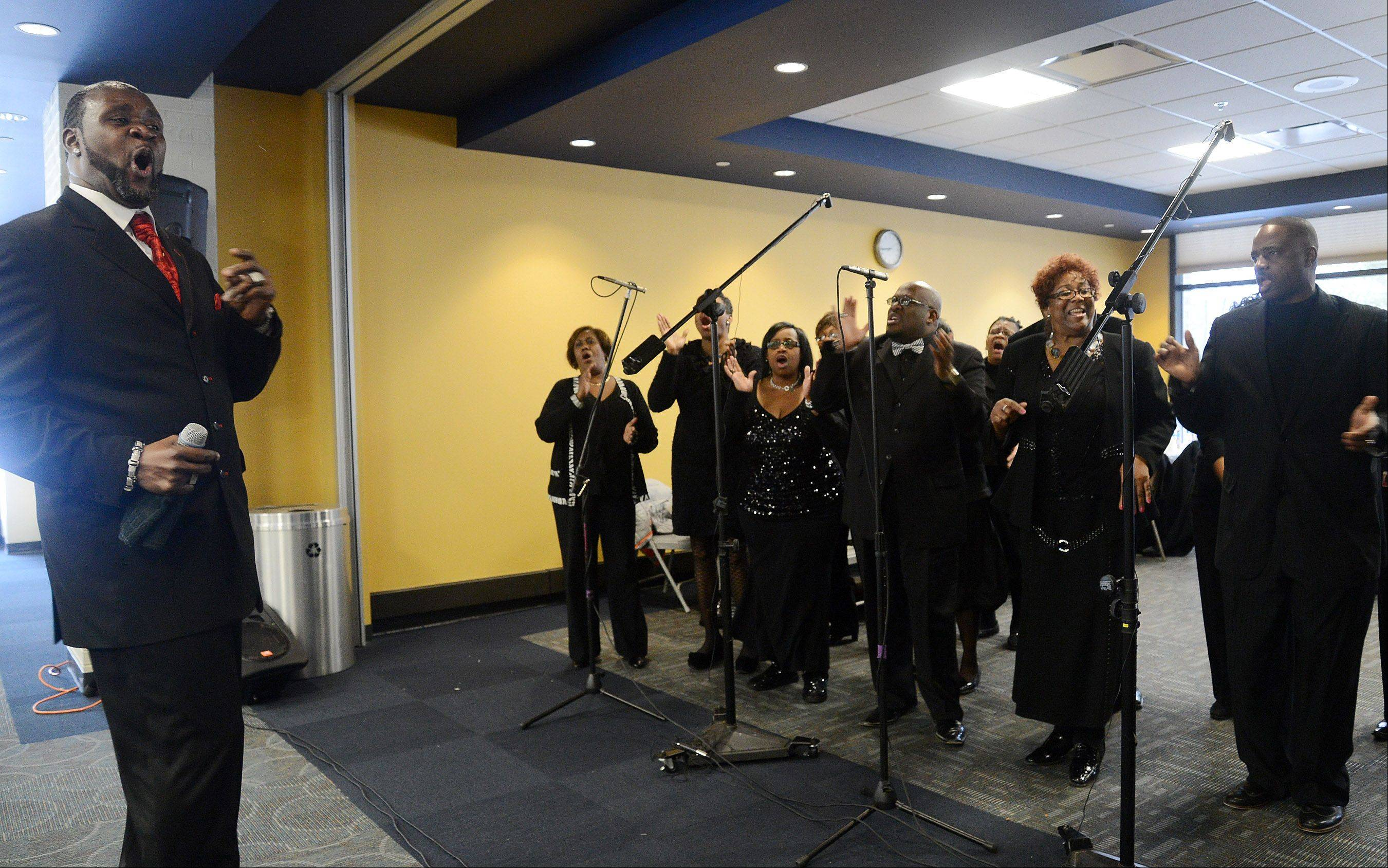 Bob Chwedyk/bchwedyk@dailyherald.comMusical director Jeff Lomax leads the Sears Holdings Associate Gospel Choir on Monday during the Hoffman Estates Cultural Awareness Commission's 12th annual Martin Luther King Jr. Community Breakfast.