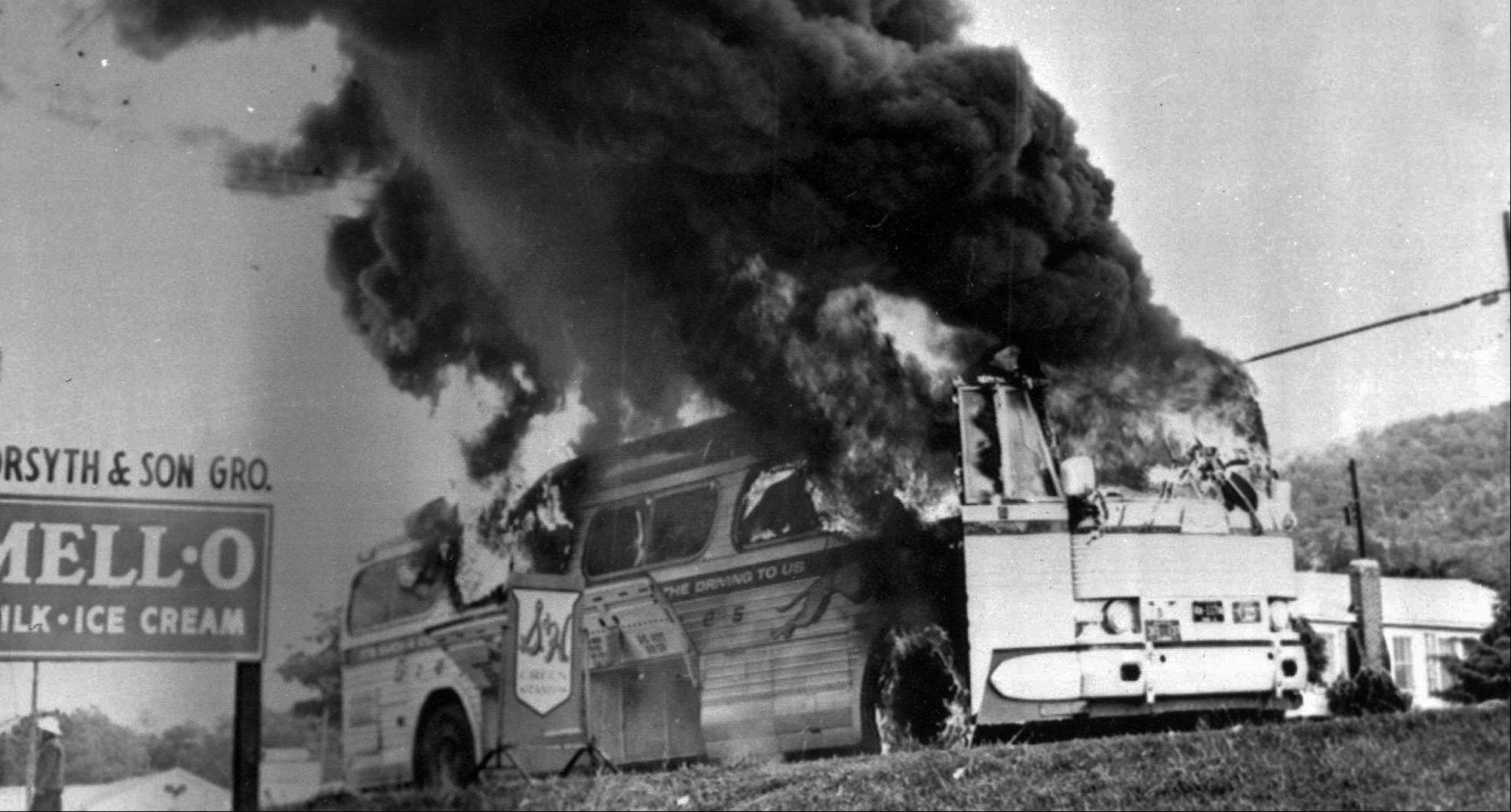 A Freedom Rider bus went up in flames when a fire bomb was tossed through a window May 15, 1961, near Anniston, Ala. Passengers escaped without serious injury.