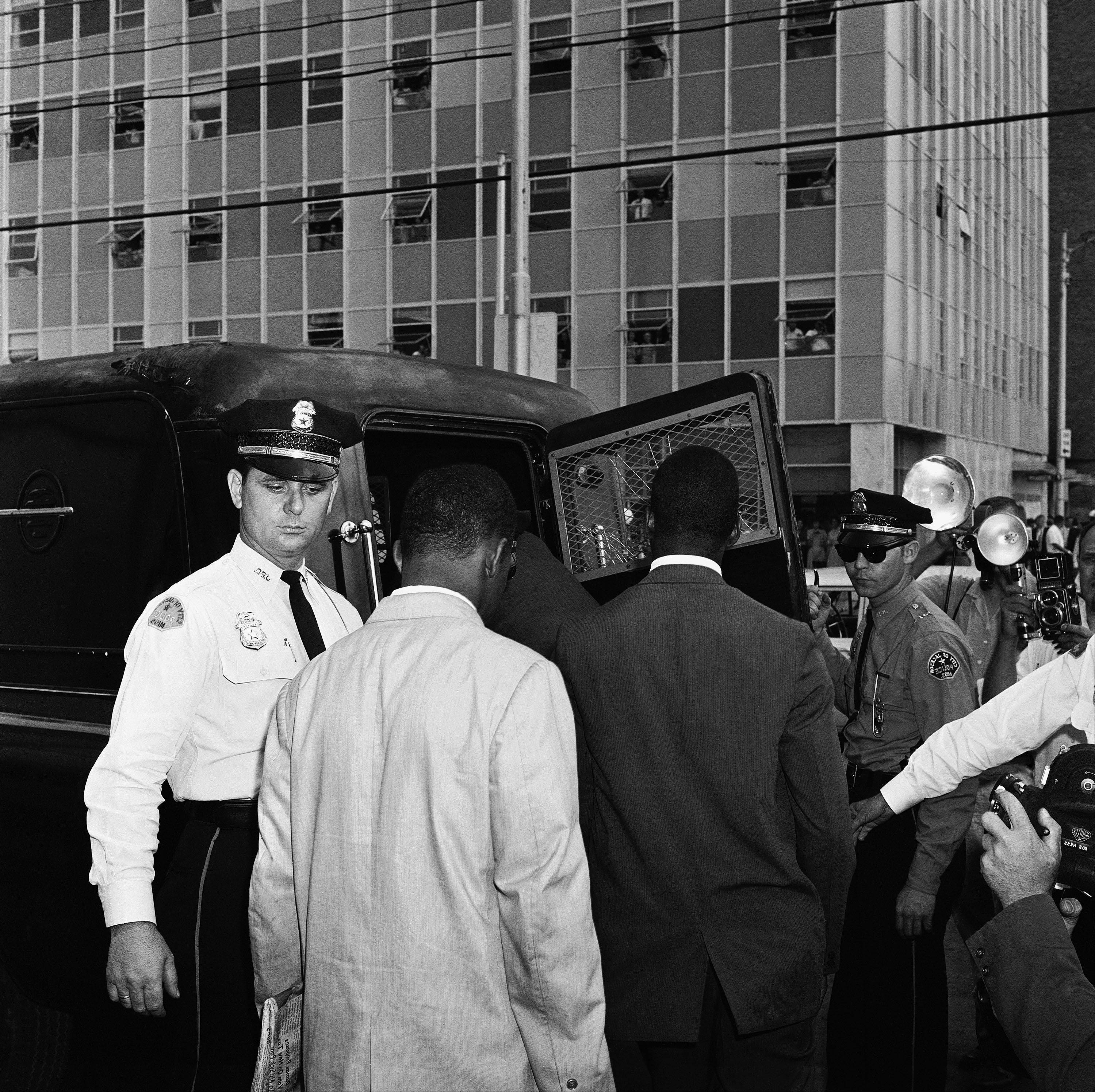 Police arrested Freedom Riders arriving in Jackson, Miss., in 1961.