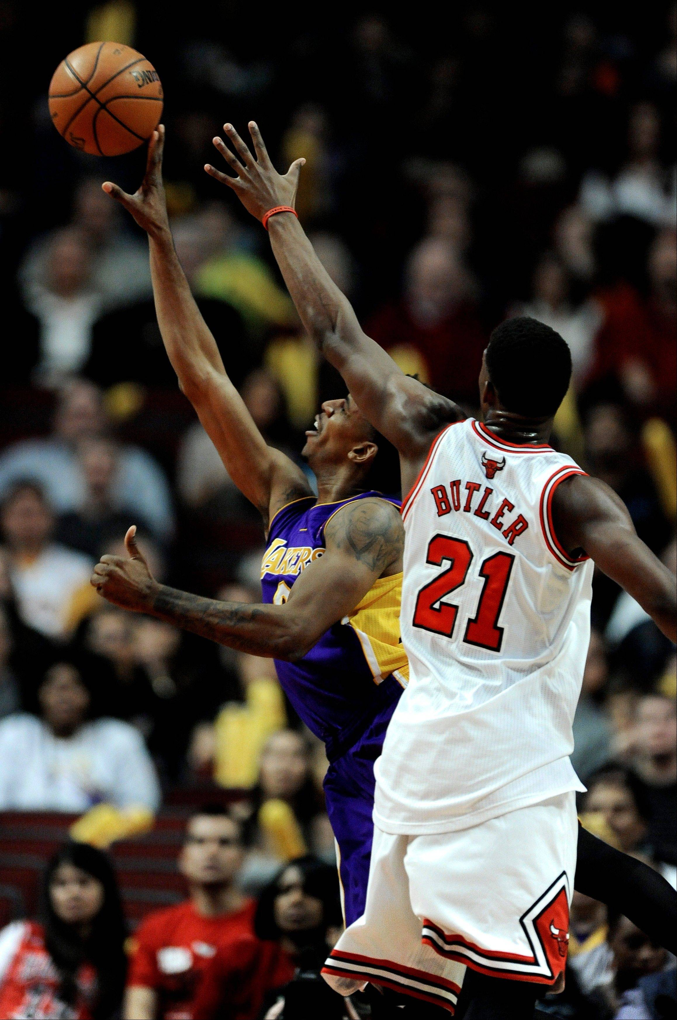 The Los Angeles Lakers' Nick Young goes up for a shot against the Bulls' Jimmy Butler during the first quarter of an NBA basketball game in Chicago, Monday, Jan., 20, 2014.