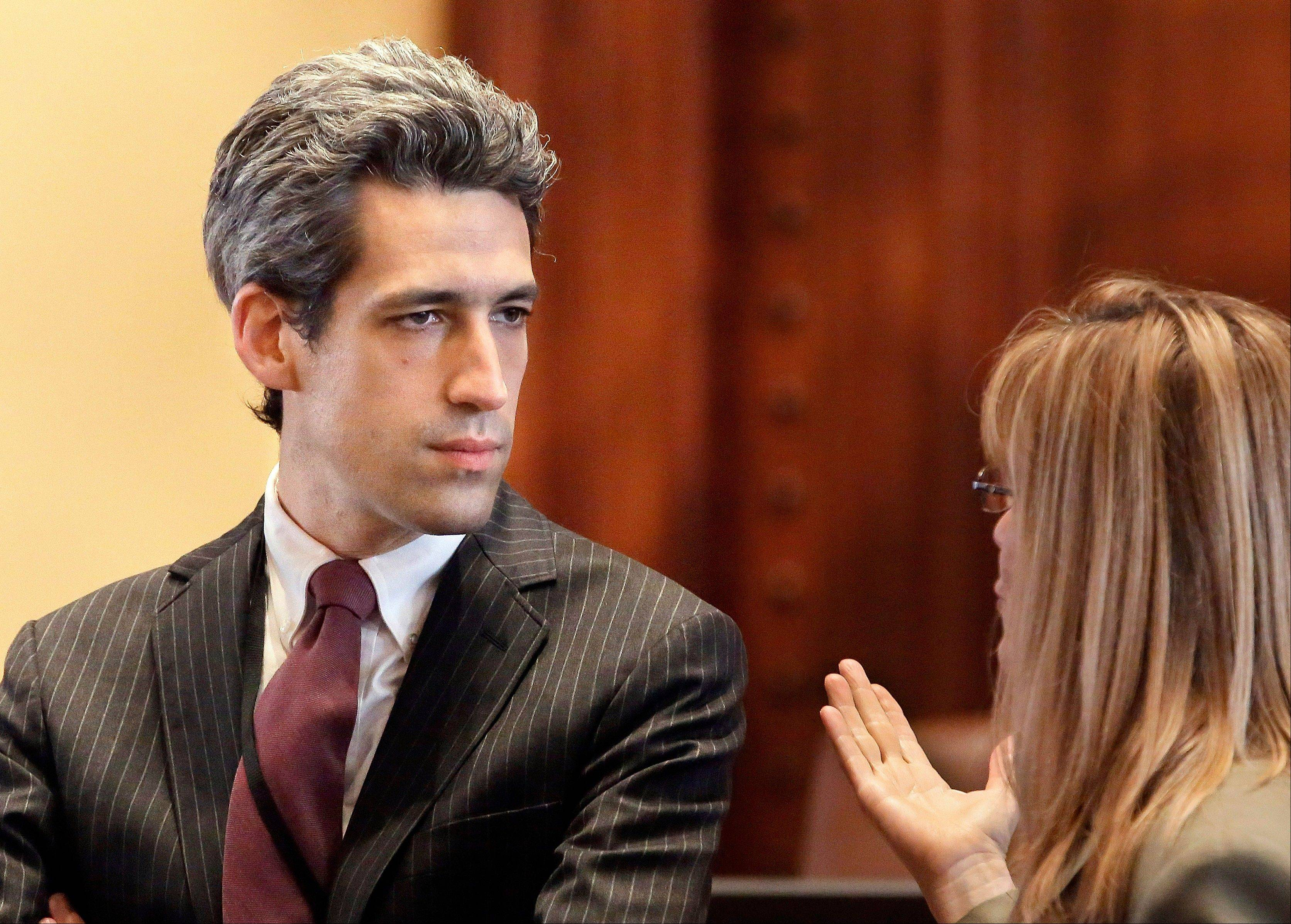 Associated Press Illinois Sen. Daniel Biss, D-Skokie speaks with a legislative staffer at the state Capitol in Springfield. A report to be released Tuesday says an Illinois $160 billion pension plan ultimately won�t make much of a dent in the state�s growing deficits.