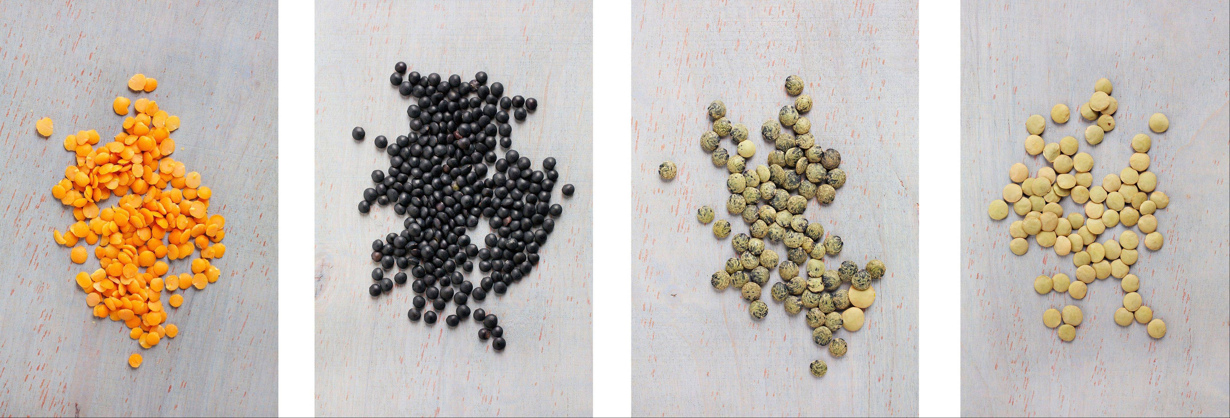 Lentils come in a variety of colors and sizes. From left, red, orange or yellow split lentils; black beluga lentils; French du Puy lentils; and brown or green lentils.