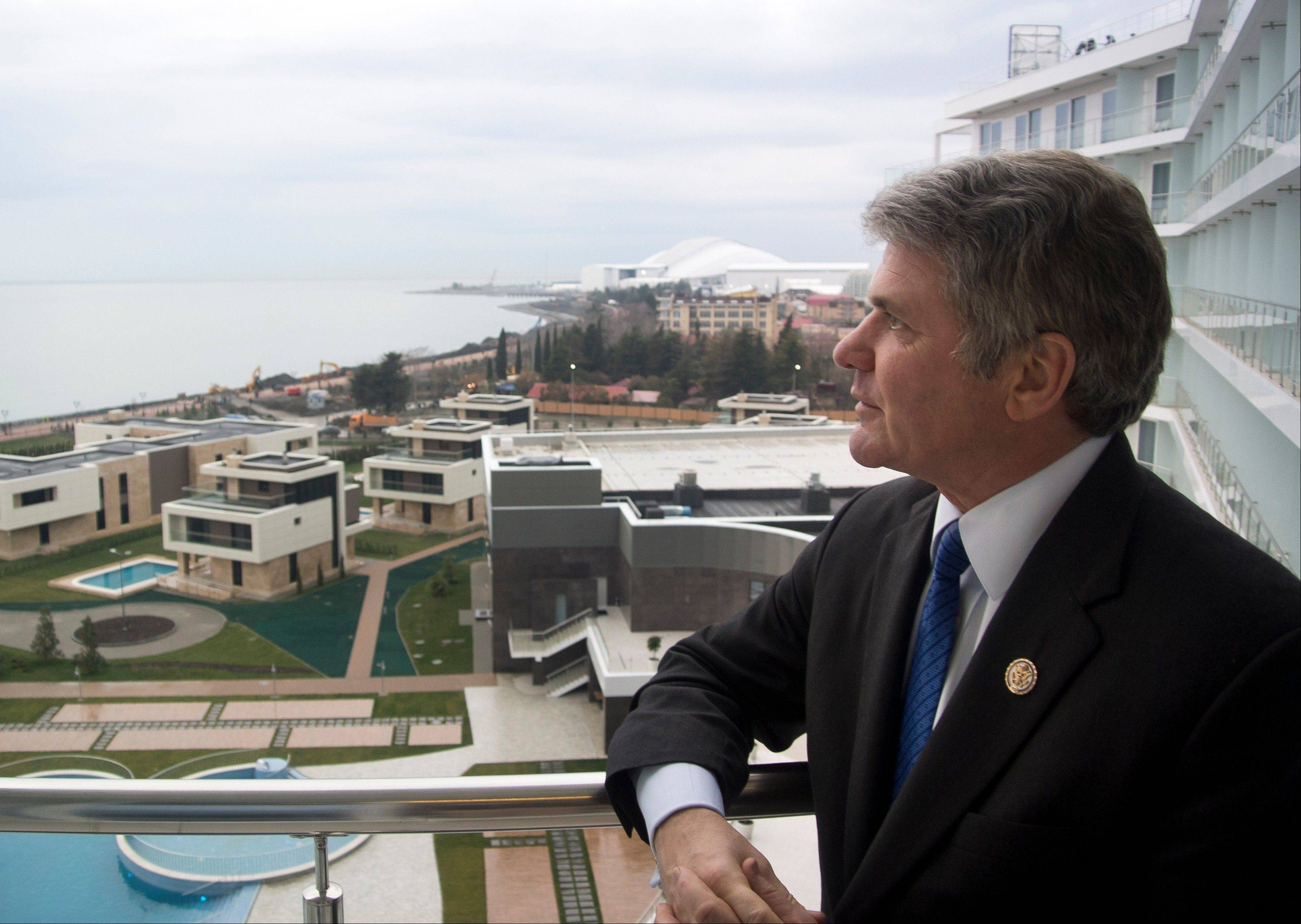 U.S. Congressman, Rep. Michael McCaul, chairman of the House Homeland Security Committee, stands of a balcony of his hotel which overlooks the Olympic Park, in the Black Sea resort of Sochi, Tuesday, McCaul, in Sochi to assess the situation, said he was impressed by the work of Russian security forces but troubled that potential suicide bombers had gotten into the city despite all of the extraordinary security measures.