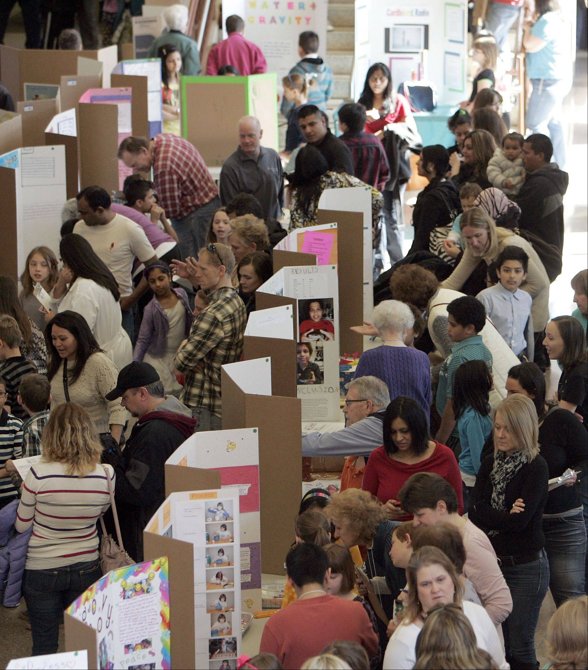 The South Elgin High School lobby swarms with students during last year�s Elgin Area School District U-46�s STEM Expo. Nearly 1,300 students presented more than 600 projects.
