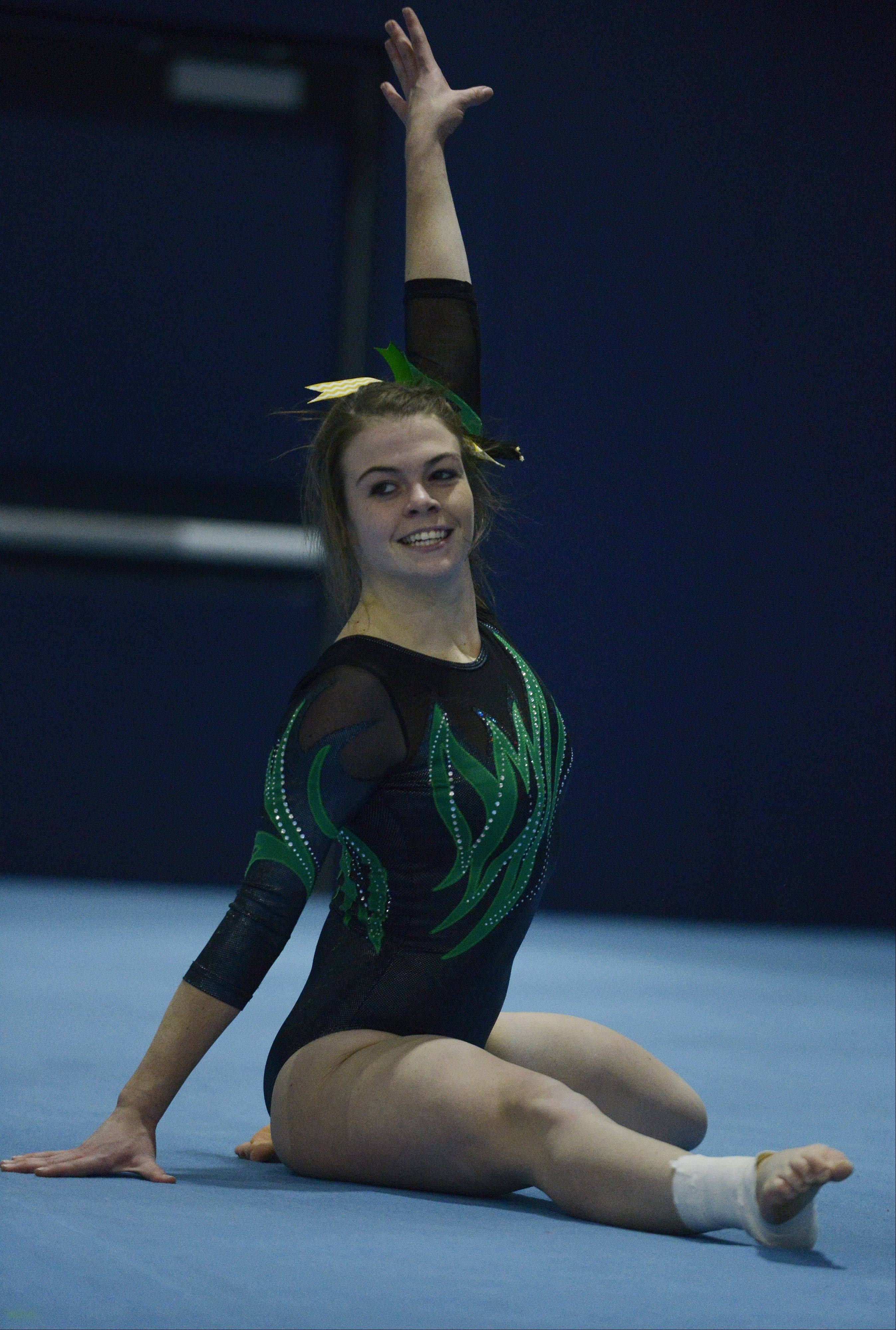Fremd�s Christine Jensen competes on the floor exercise during Tuesday�s meet with Hoffman Estates and host Conant.