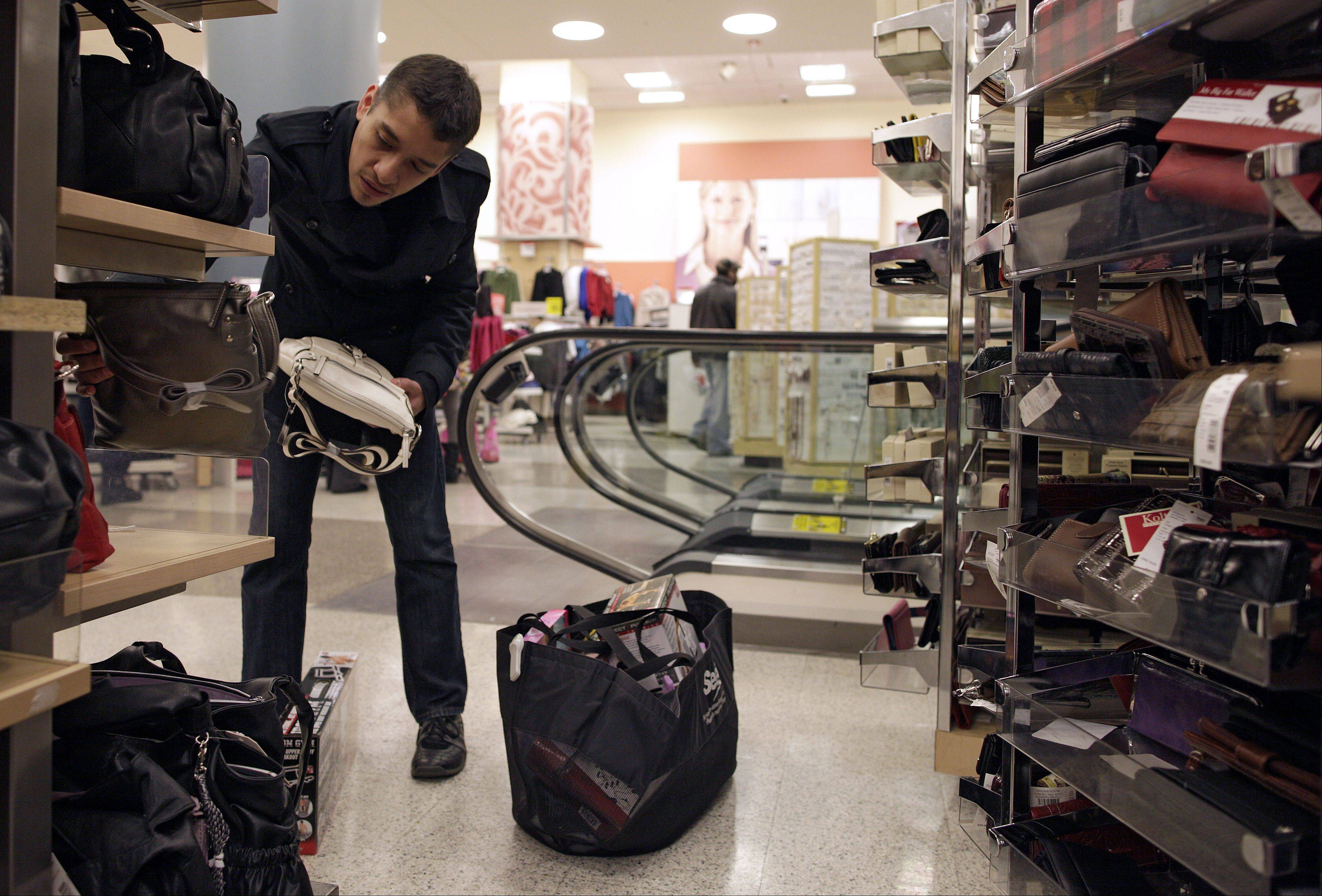 In this photo from 2009, Steve Barrera of Chicago gets in some last-minute holiday shopping at a Sears store in Chicago.