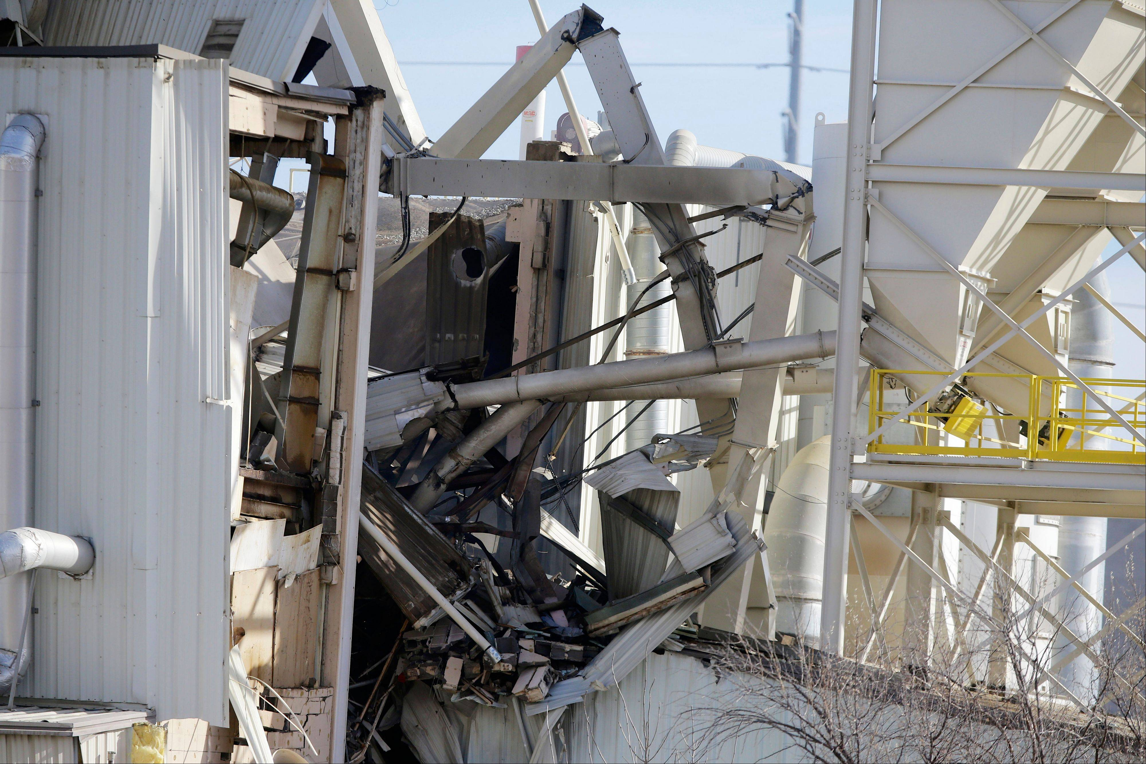 The International Nutrition plant is in wreckage in Omaha, Neb., where a fire and explosion took place Monday, Jan. 20, 2014. Two workers were killed and 10 were hospitalized with significant injuries.