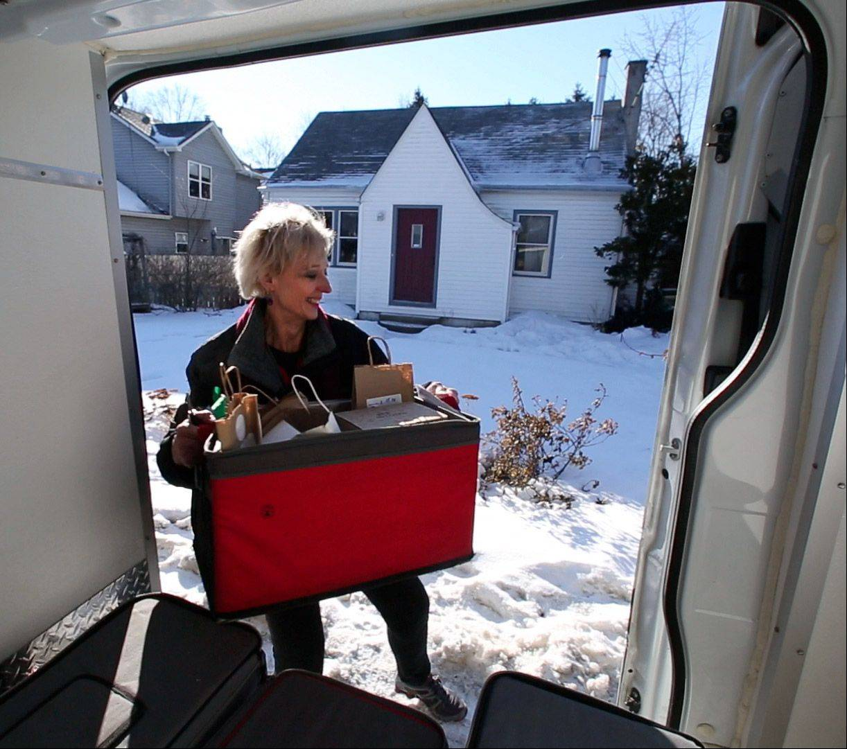 Doreen Melchiorre, a driver for Artizone, delivers a grocery order in Lake Zurich.