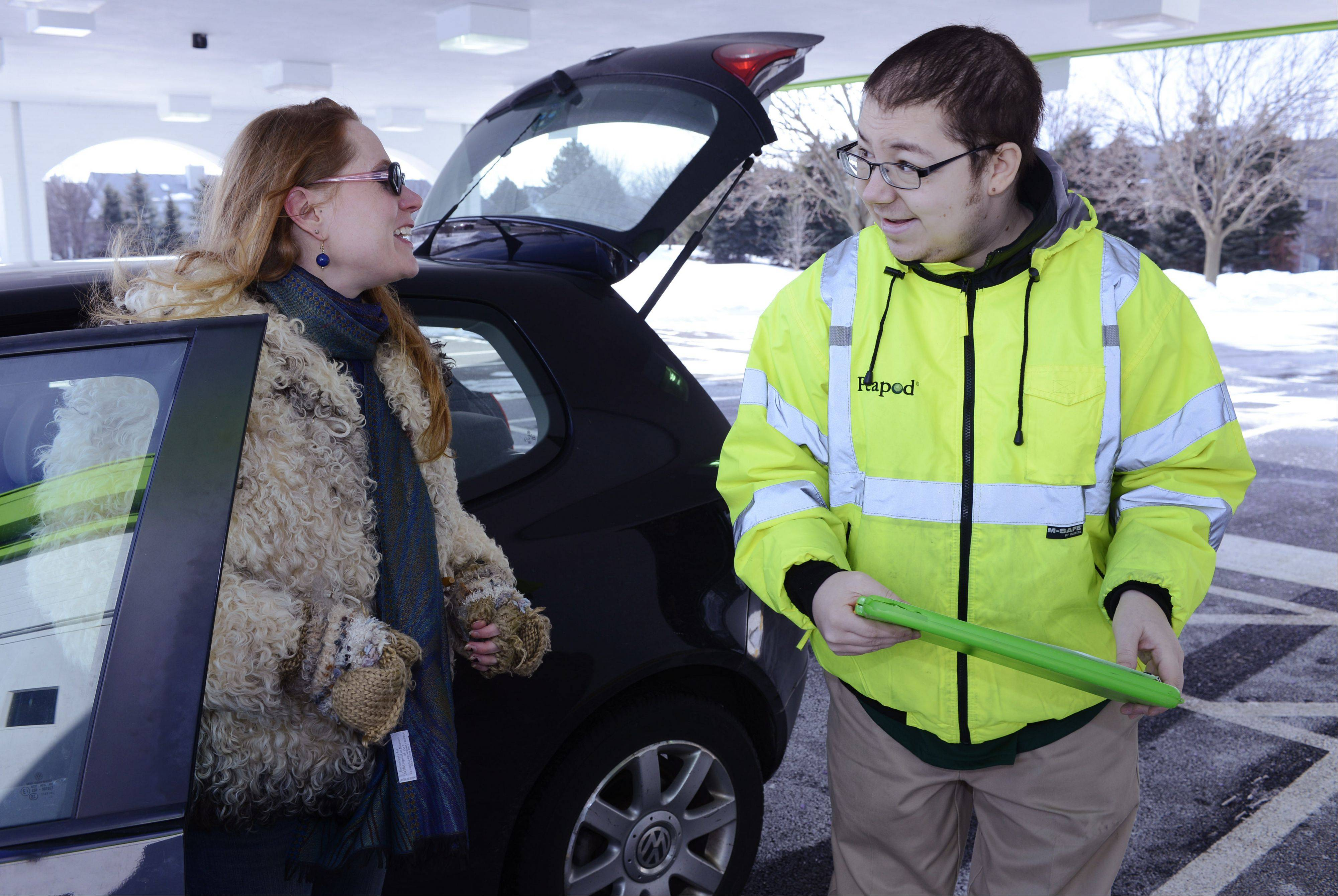 "Christa Chockley of Hanover Park checks in with attendant Brandan White at the ""Peapod Pick-up"" location in Schaumburg Friday."
