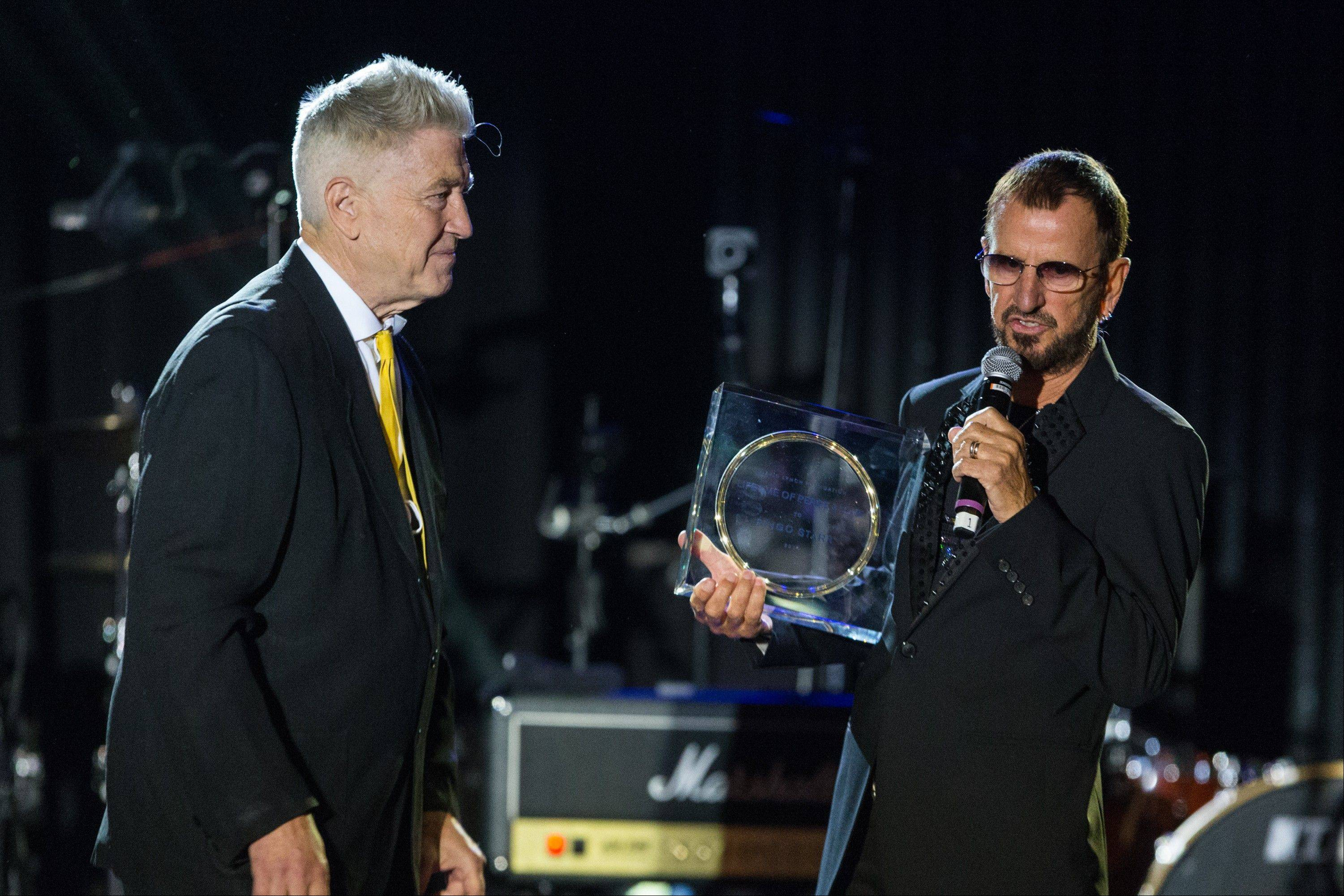 "Director David Lynch, left, presents musician Ringo Starr with the Lifetime of Peace & Love Award onstage during the David Lynch Foundation Honors Ringo Star ""A Lifetime of Peace & Love"" event held Monday in Los Angeles."