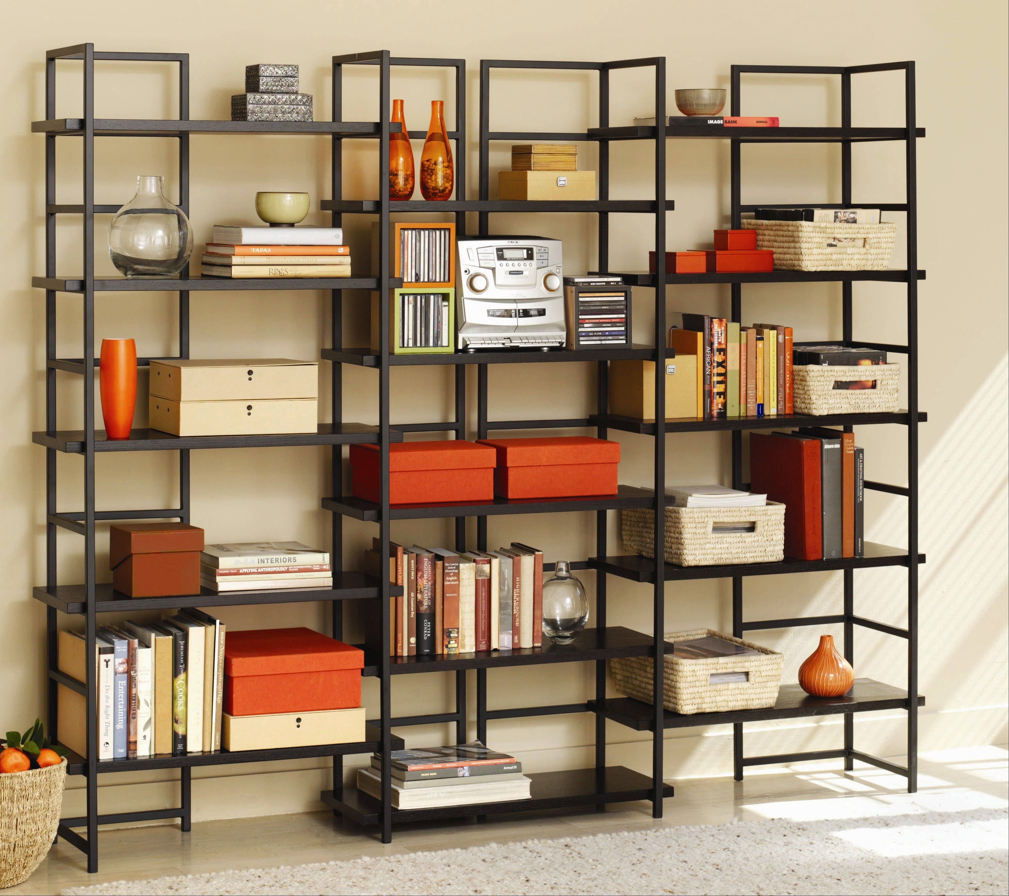 An open-backed modern bookcase can be used to divide rooms or set the perimeter of a library-focused space. Contemporary home libraries utilize room for books or artwork that speak to the aesthetic and spirit of the space.
