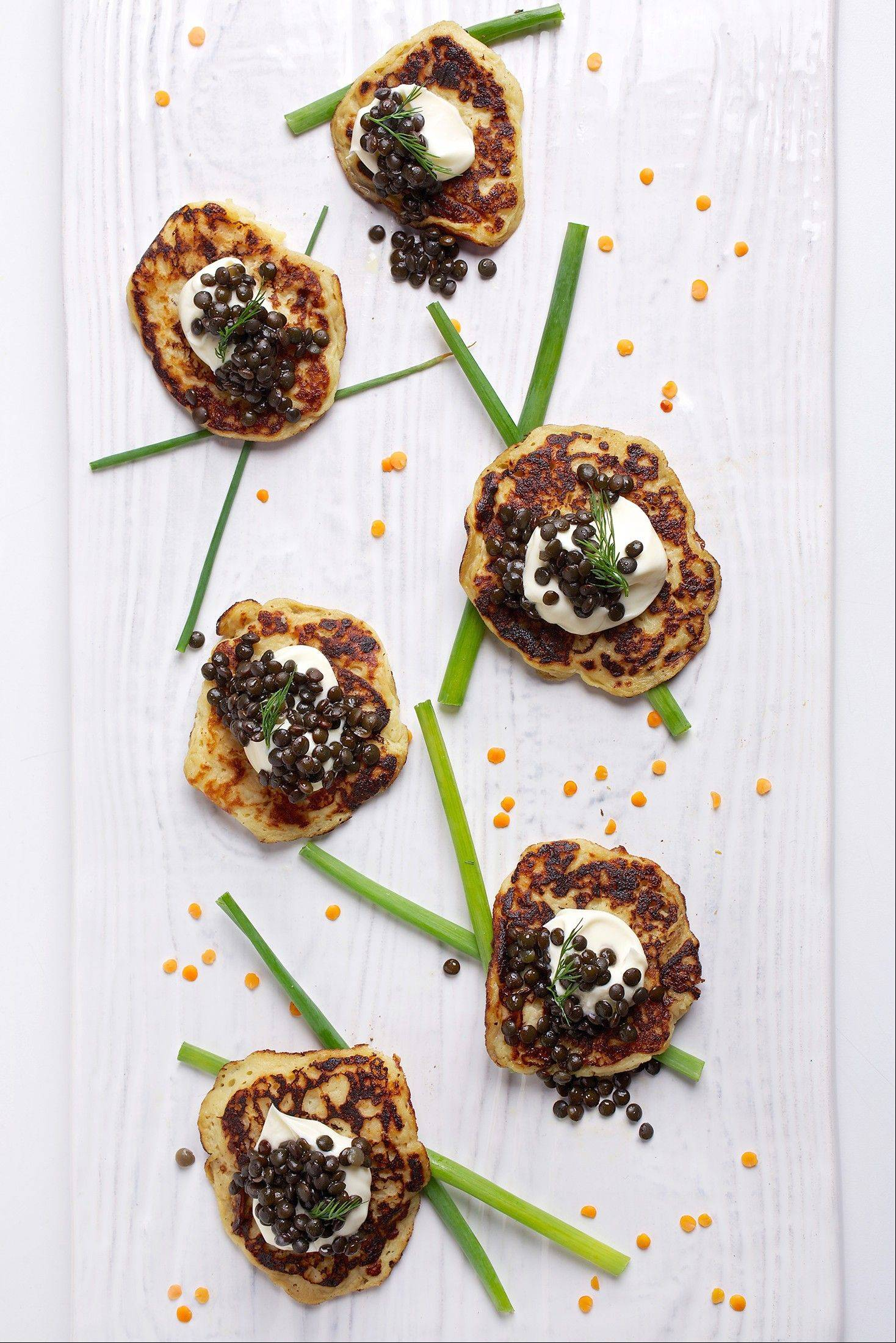 Lentils have countless culinary uses way beyond soups and stews, like these beluga lentils served caviar-style on potato blini.