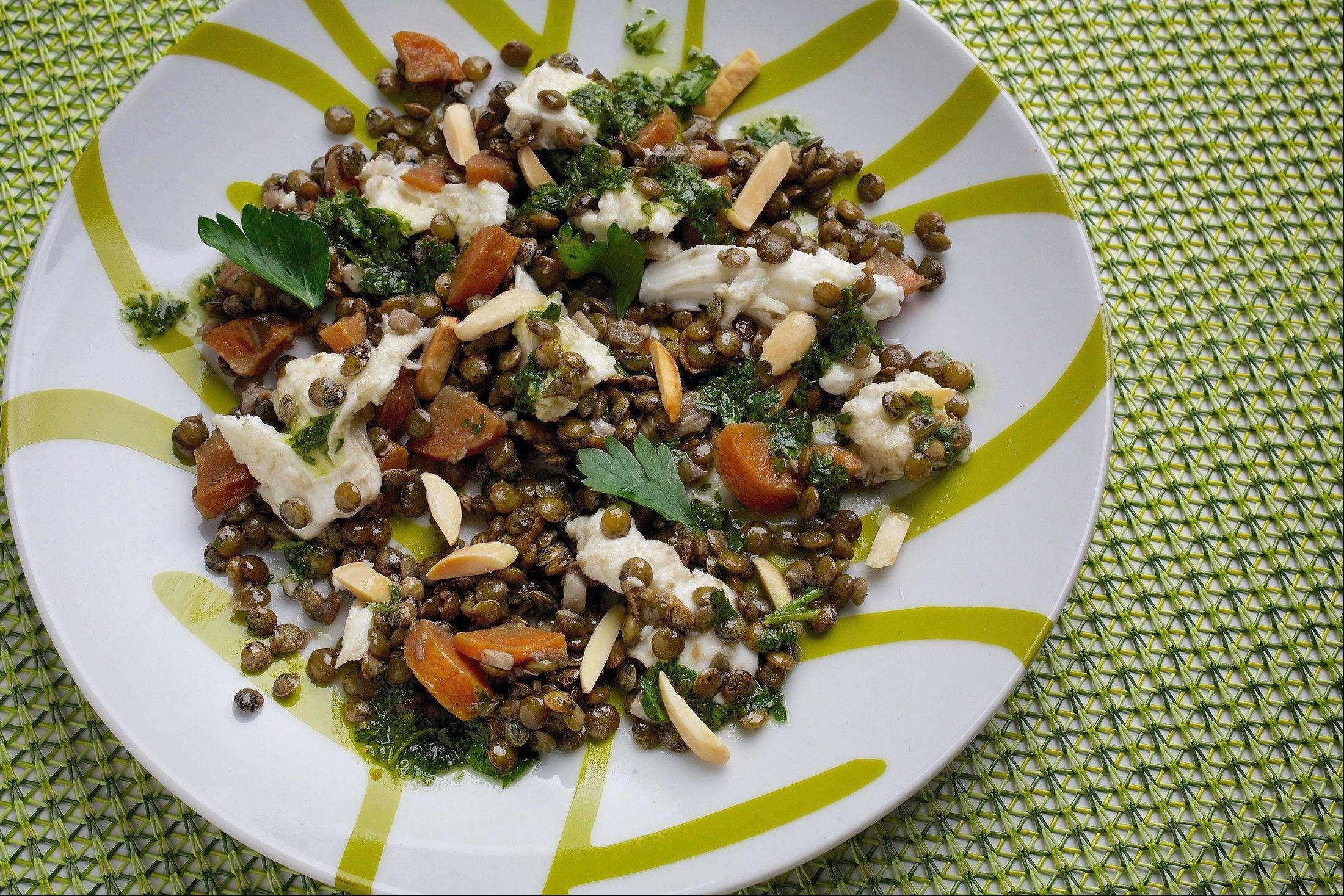 Creamy, fresh mozzarella pairs well with earthy lentils, sharpened with a vinaigrette.