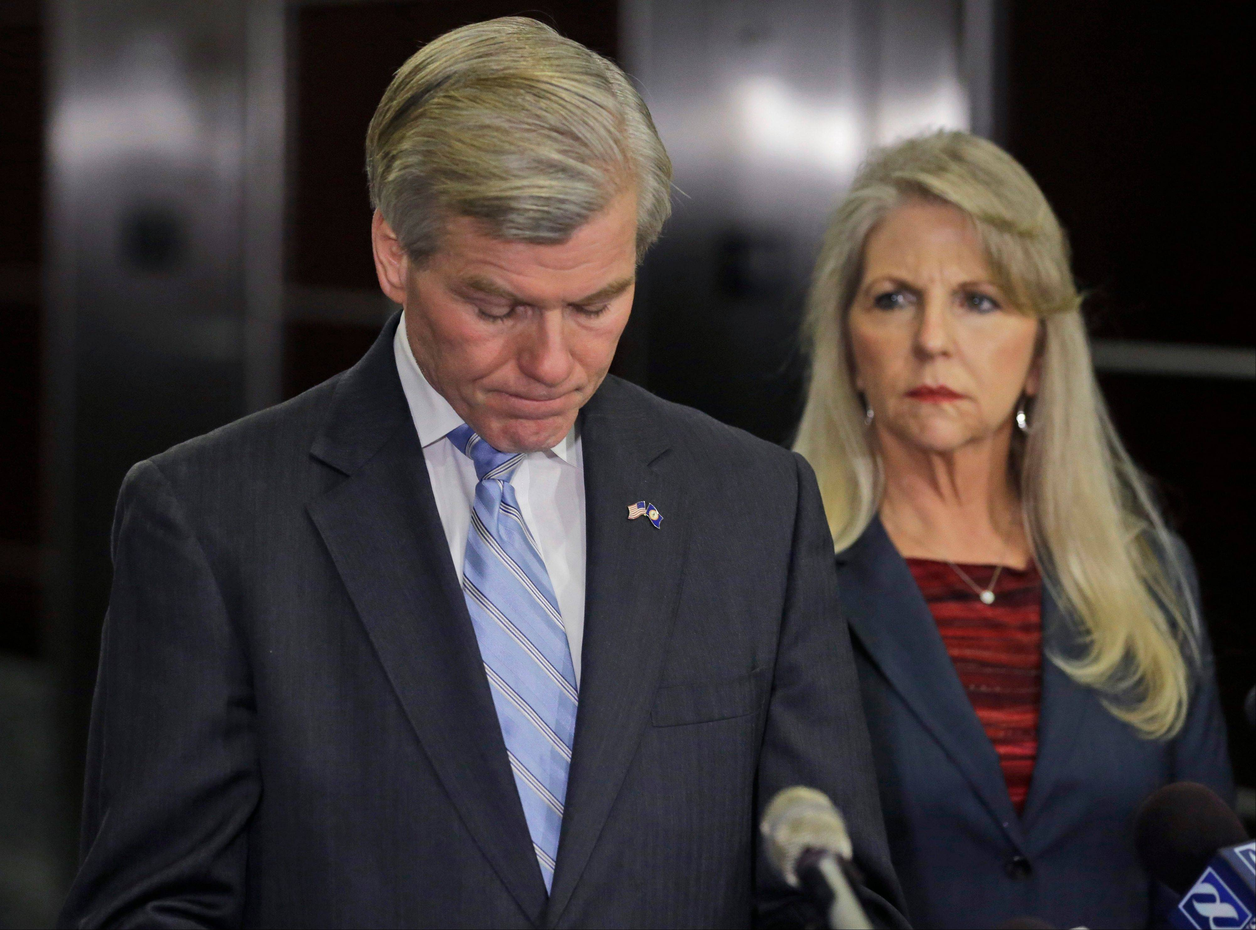 Former Virginia Gov. Bob McDonnell pauses while making a statement as his wife, Maureen, right, listens, in Richmond, Va., Tuesday.