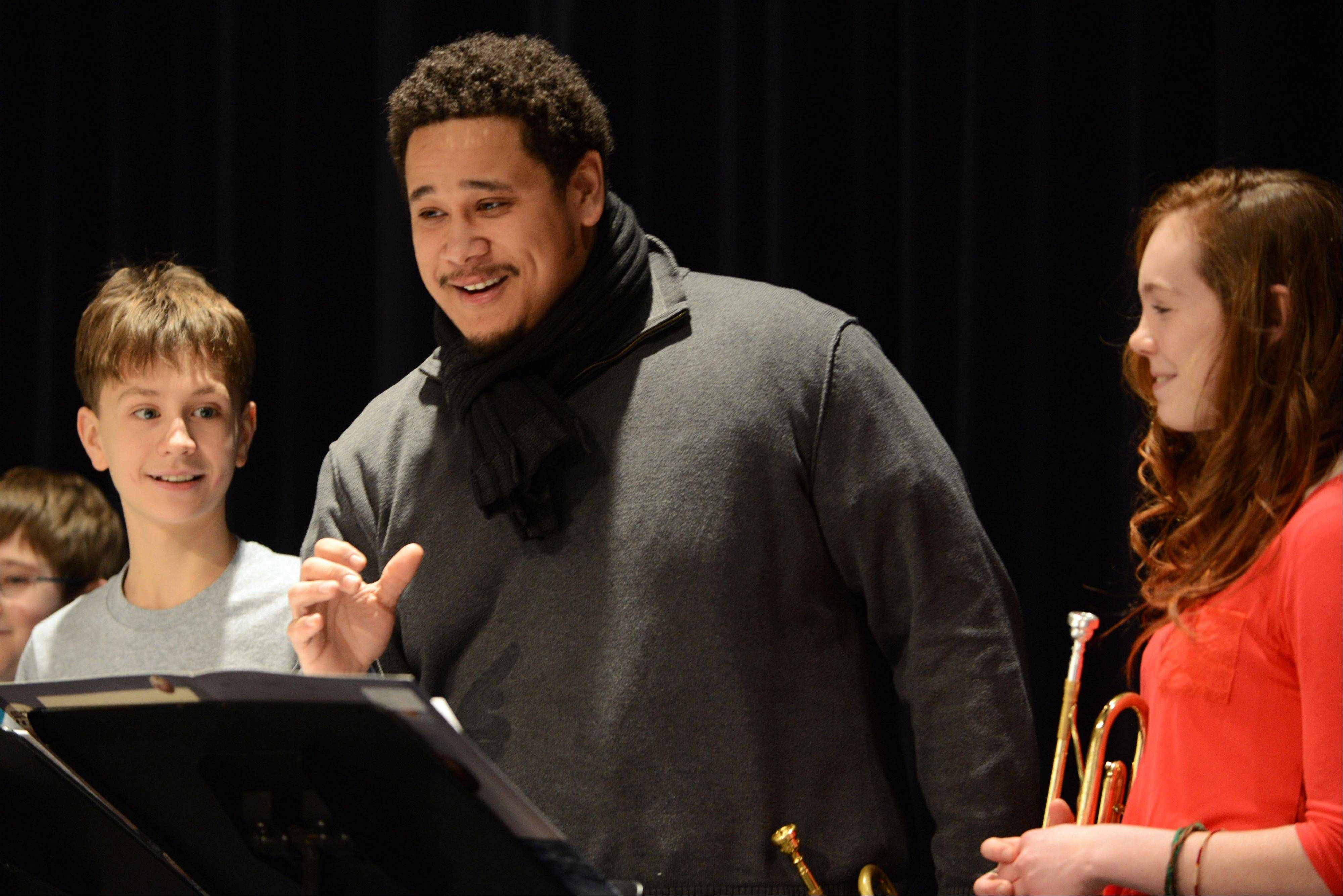 Professional Chicago musician Marques Carroll works with Highland Middle School Jazz I students Ben Johnson, left, and Annalisa Waddick during a Jazz Festival clinic Tuesday at Libertyville High School.