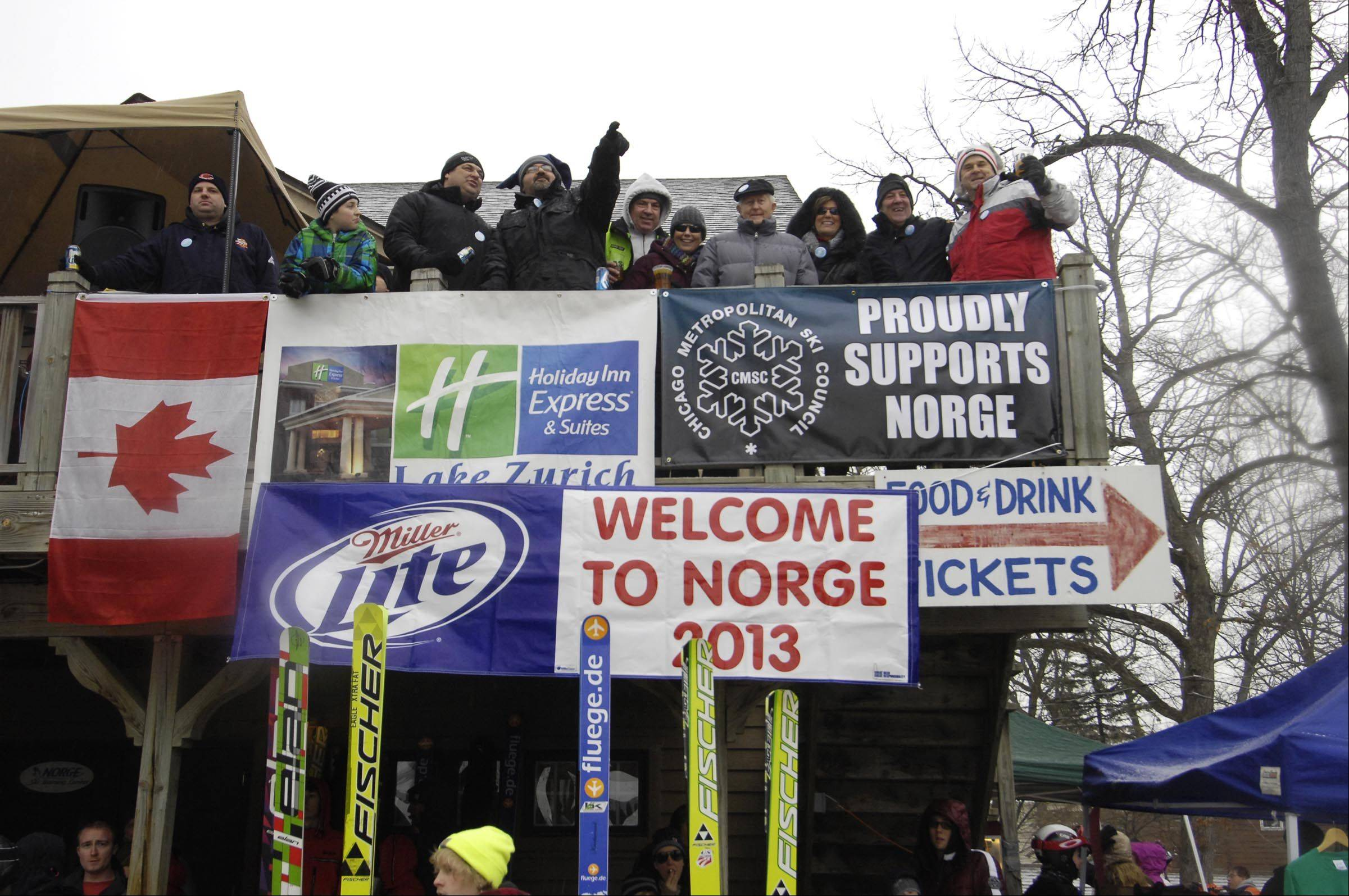 Spectators watch from the club house at the 108th Annual International Ski Jumping Tournament at Norge Ski Club Hill in Fox River Grove.