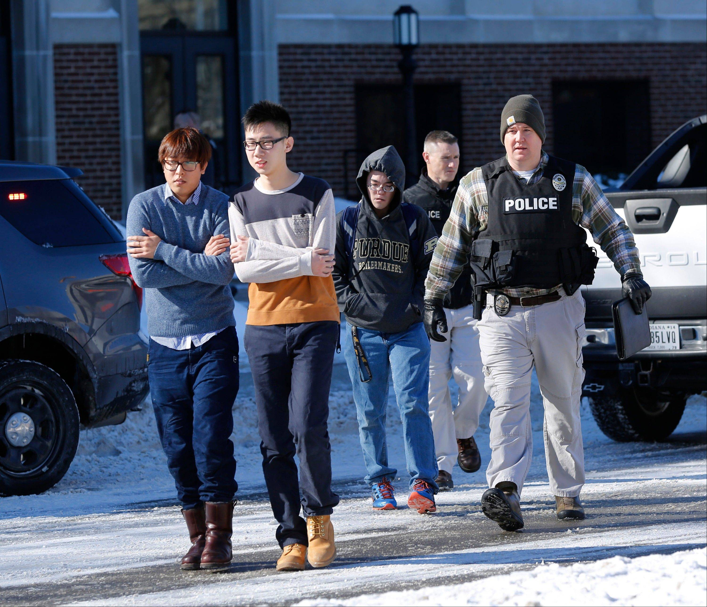 Police evacuate students from the Electrical Engineering building after shots were fired Tuesday on the campus of Purdue University in West Lafayette, Ind. Officials at Purdue University say one person was killed in a shooting at the campus classroom building.