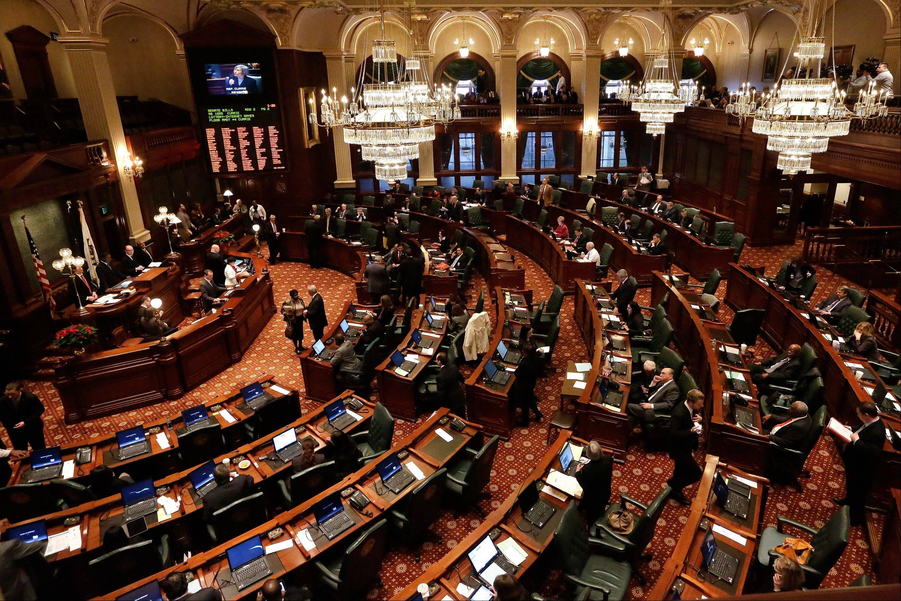 Lawmakers worked toward passing pension legislation while on the House floor during session in December 2013 at the Illinois State Capitol in Springfield.