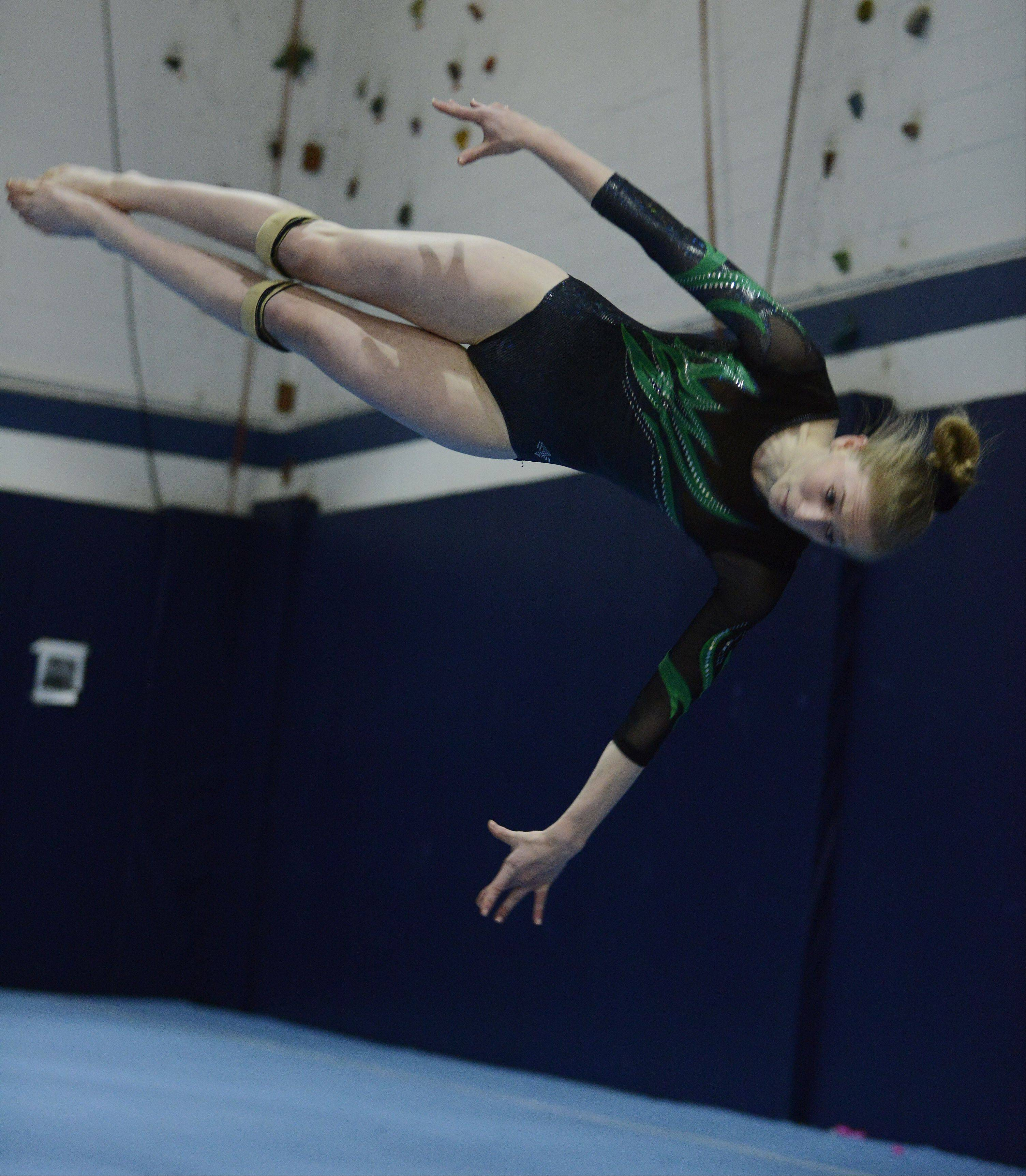 Fremd's Grace Korn competes on the floor exercise during Tuesday's gymnastics meet with Hoffman Estates and host Conant.