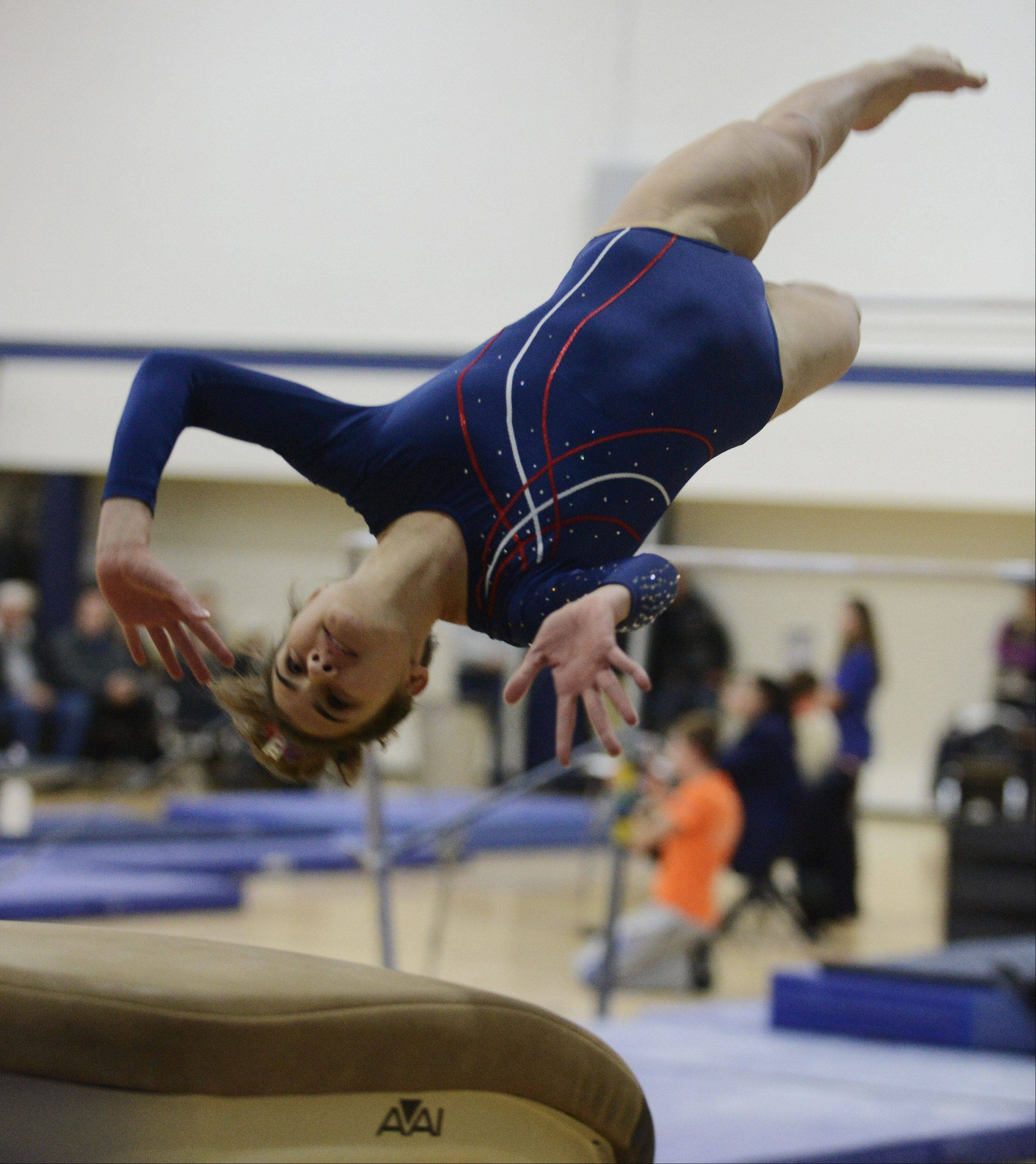Conant's Gina Massa competes on vault during Tuesday's home meet with Hoffman Estates and Fremd.
