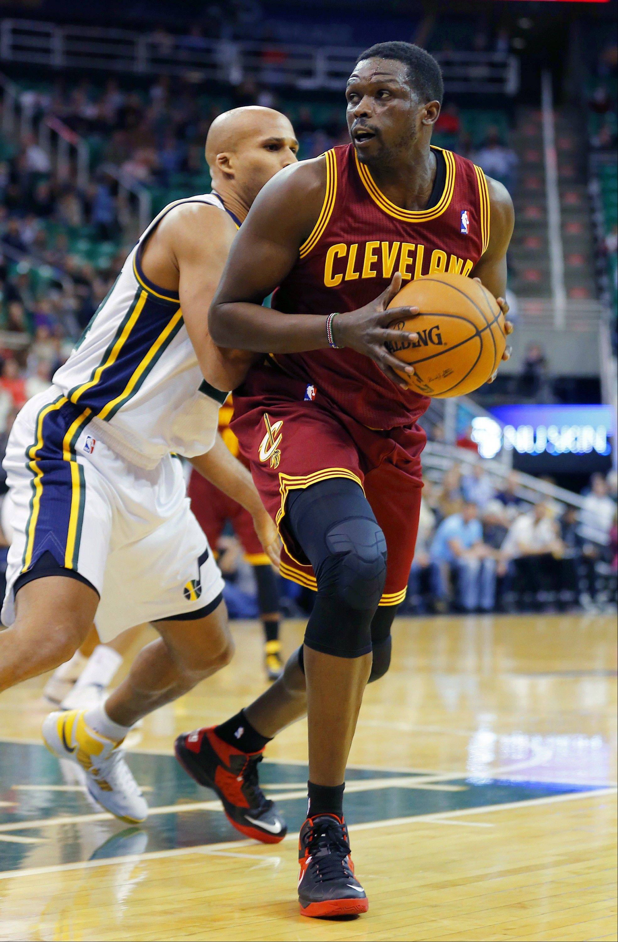 Cleveland Cavalier's Luol Deng, right, looks to shoot over Utah Jazz's Richard Jefferson during an NBA basketball game in Salt Lake City, Friday, Jan. 10, 2014.