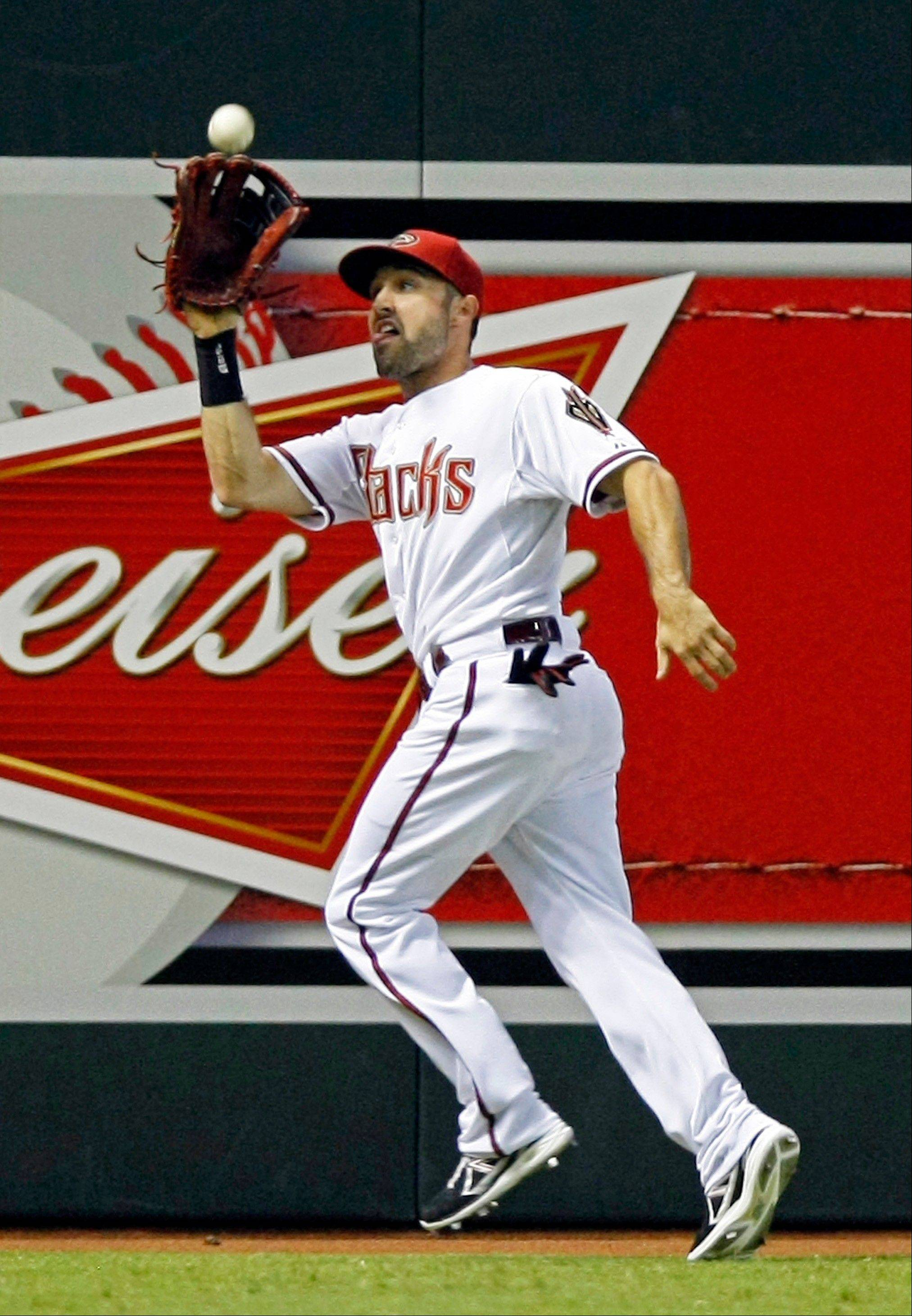 Left fielder Adam Eaton makes a running catch for the Diamondbacks against the Orioles in Phoenix.