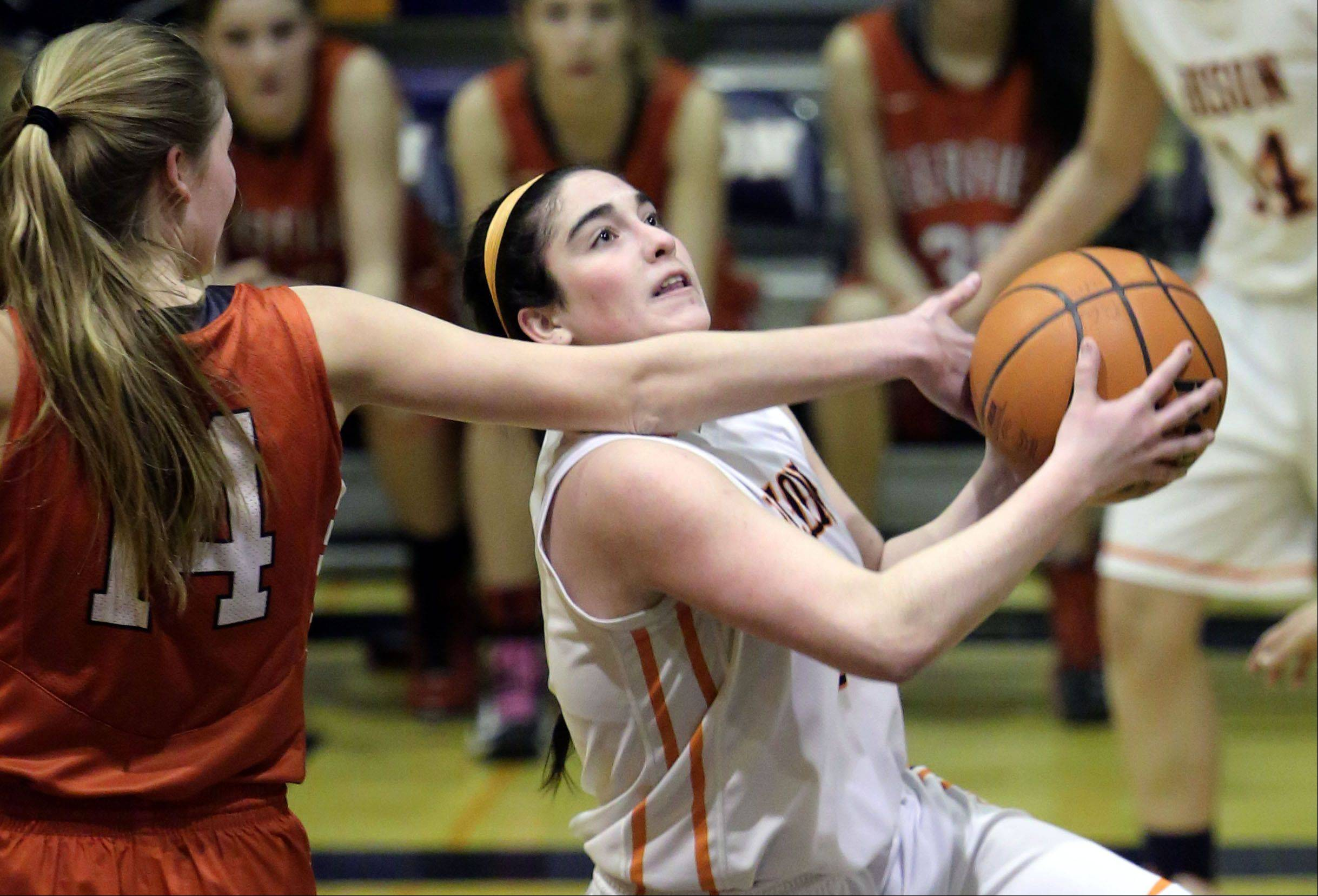 Buffalo Grove's Julie Jambrone, right, powers past Deerfield's Monica Fishbein during Monday's game in Buffalo Grove.
