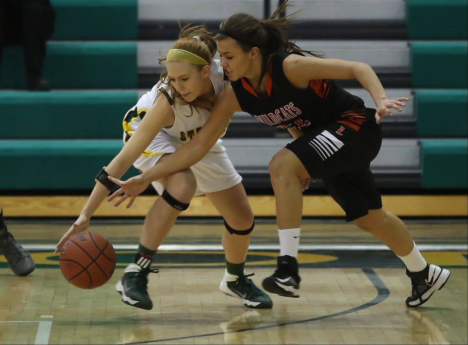 Stevenson's Jessica Burke, left, steals the ball from Libertyville's Mary Wilterdink during Thursday's game in Lincolnshire.