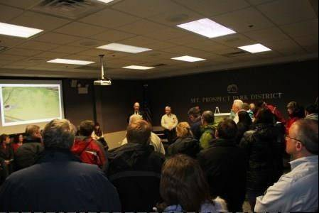 Residents from Arlington Heights and Mount Prospect attend a public input meeting Jan. 9, to view conceptual drawings and have questions answered about the new dog area at Melas Park.