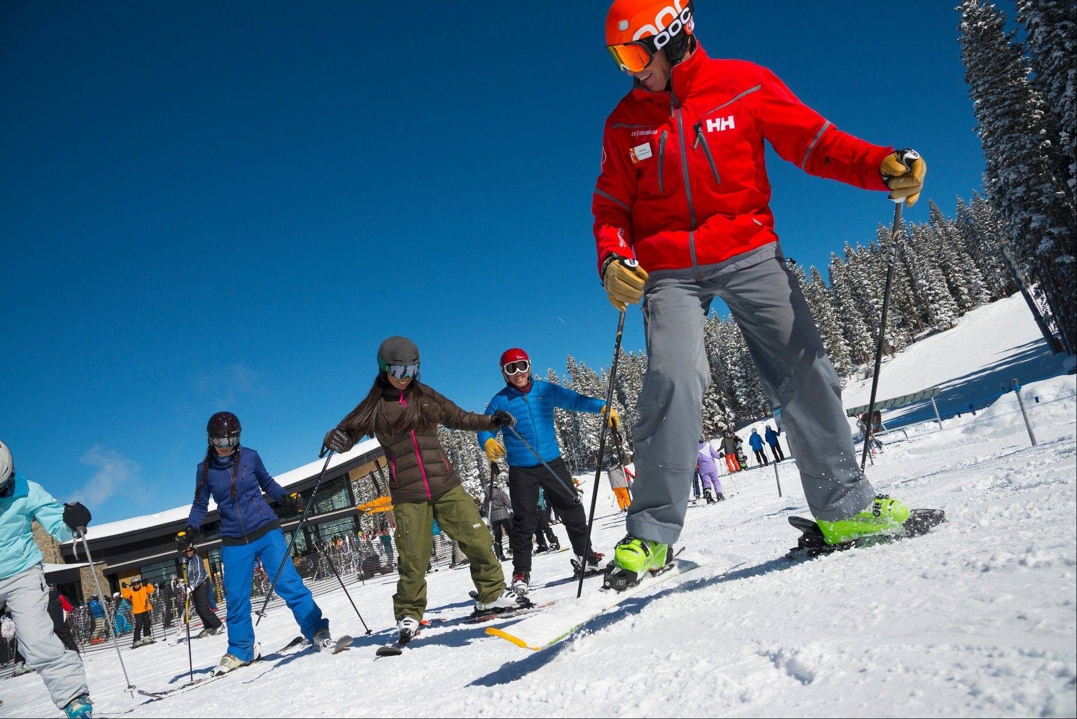 Beginners take a group class at Elk Camp ski school at Snowmass in Aspen, Colo. Planning a ski vacation for couples can be tricky if one person is an expert and the other a novice. Making plans to ski separately with time for lessons, as well as some together time on intermediate slopes, can make the vacation work smoothly.