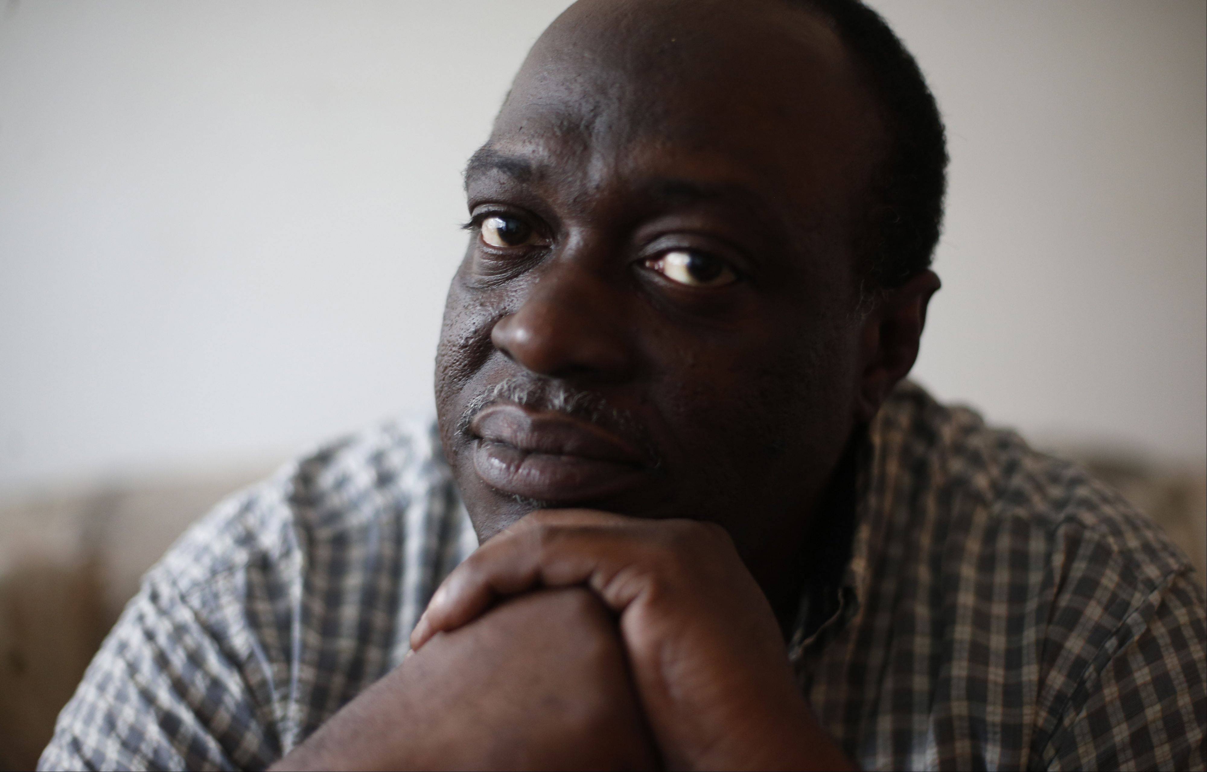 Broderick Alexander, 48, sits in his apartment on Chicago�s West Side. Knowing he has a safe place to return at night helps Alexander focus on taking his medications and staying out of the emergency room.