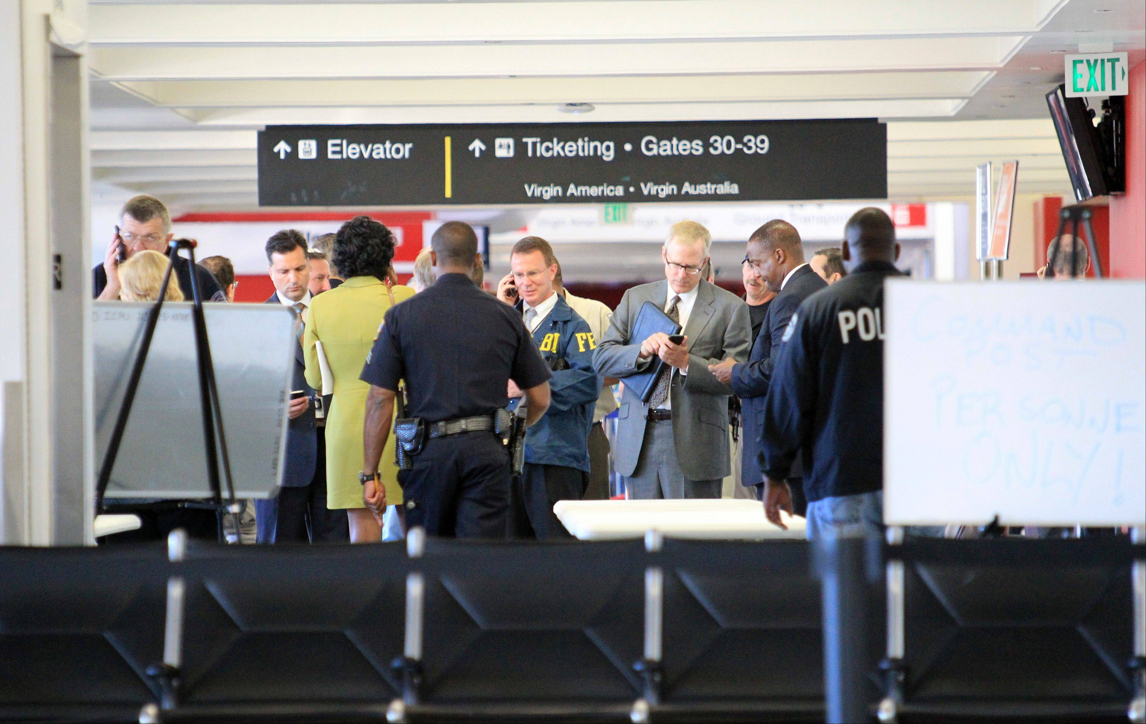 Minutes before a gunman opened fire in a Los Angeles International Airport terminal last fall, killing a security screener and wounding three other people, the two armed officers (not seen in this photo) assigned to the area left for breaks without informing a dispatcher as required.