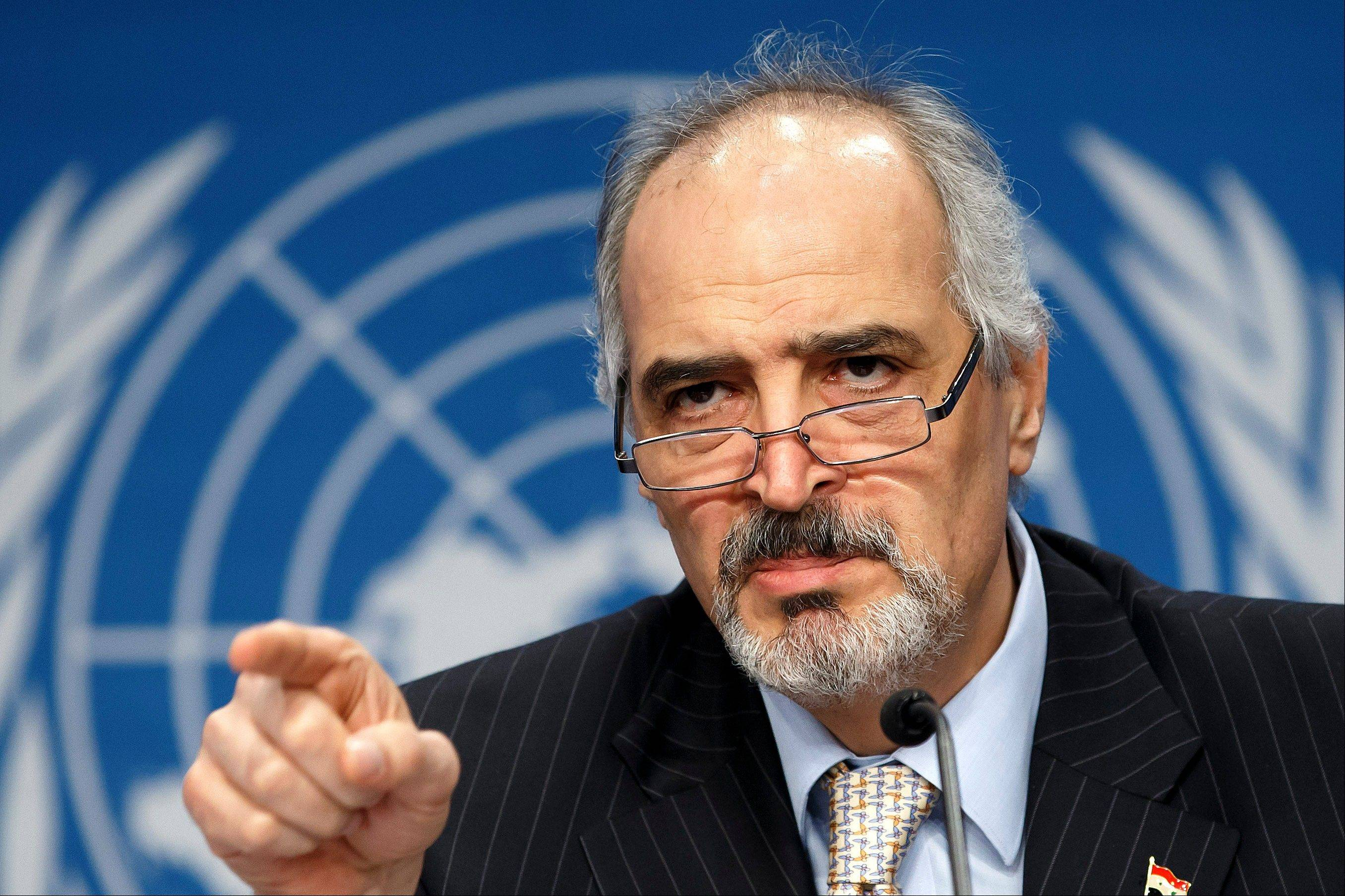 Syrian Ambassador to the United Nations, Bashar Ja'afari, speaks during a press conference Wednesday, the first day of Syrian peace talks in Montreux, Switzerland.