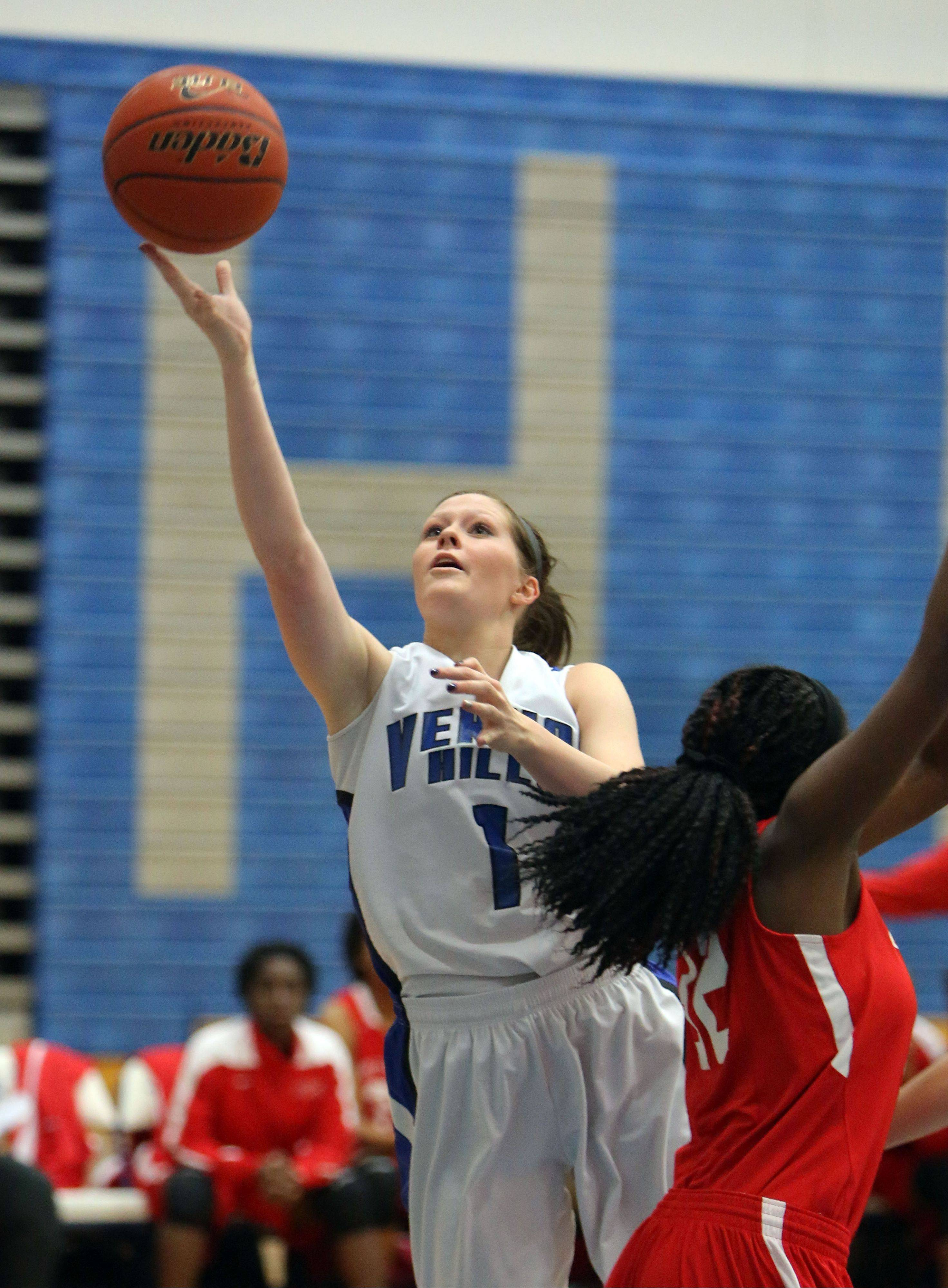 Vernon Hills' Sydney Smith drives past North Chicago's Kylah Collins on Wednesday at Vernon Hills.