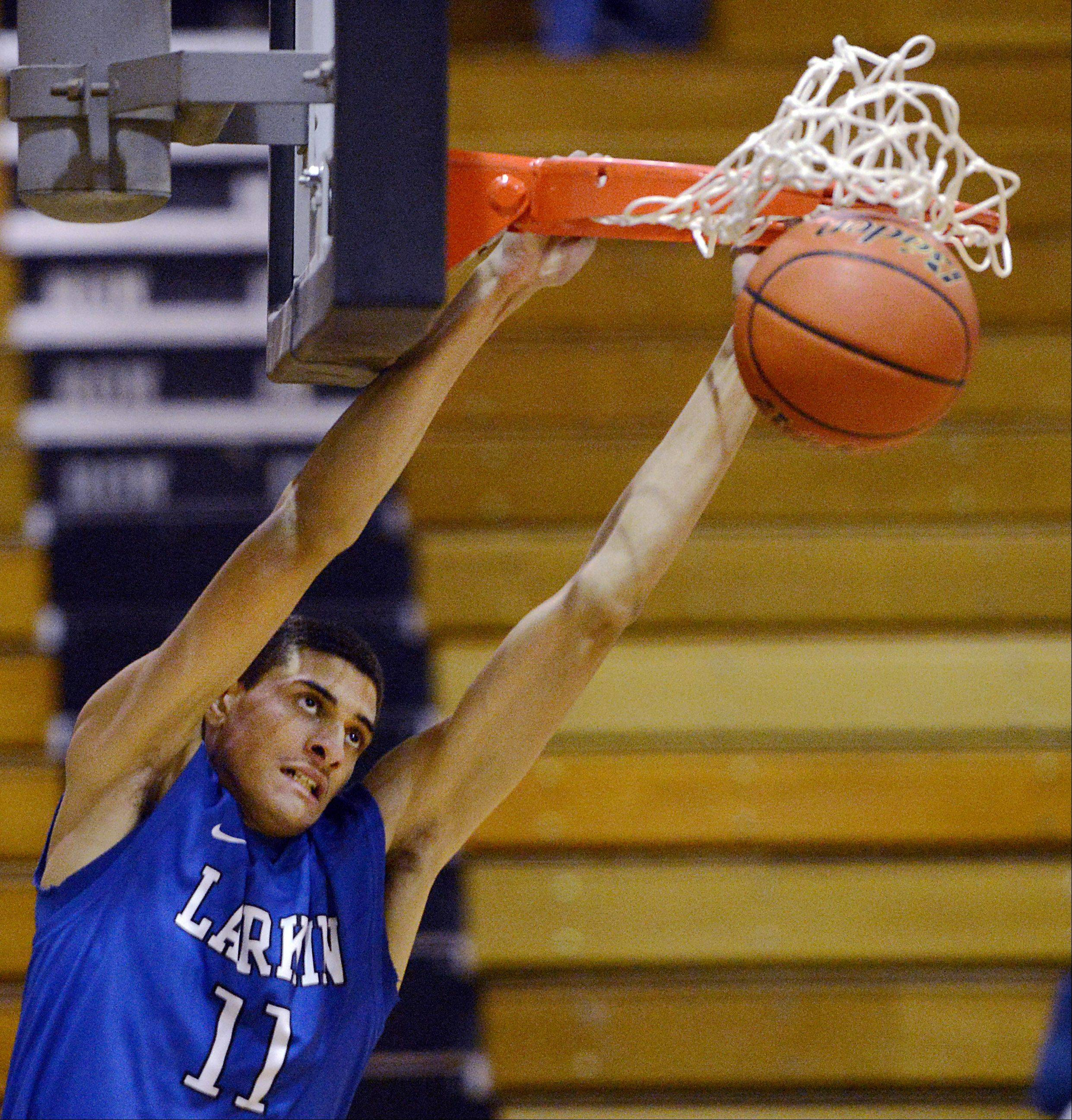 Larkin's Christian Negron slams home the first points of the game Wednesday in Streamwood.