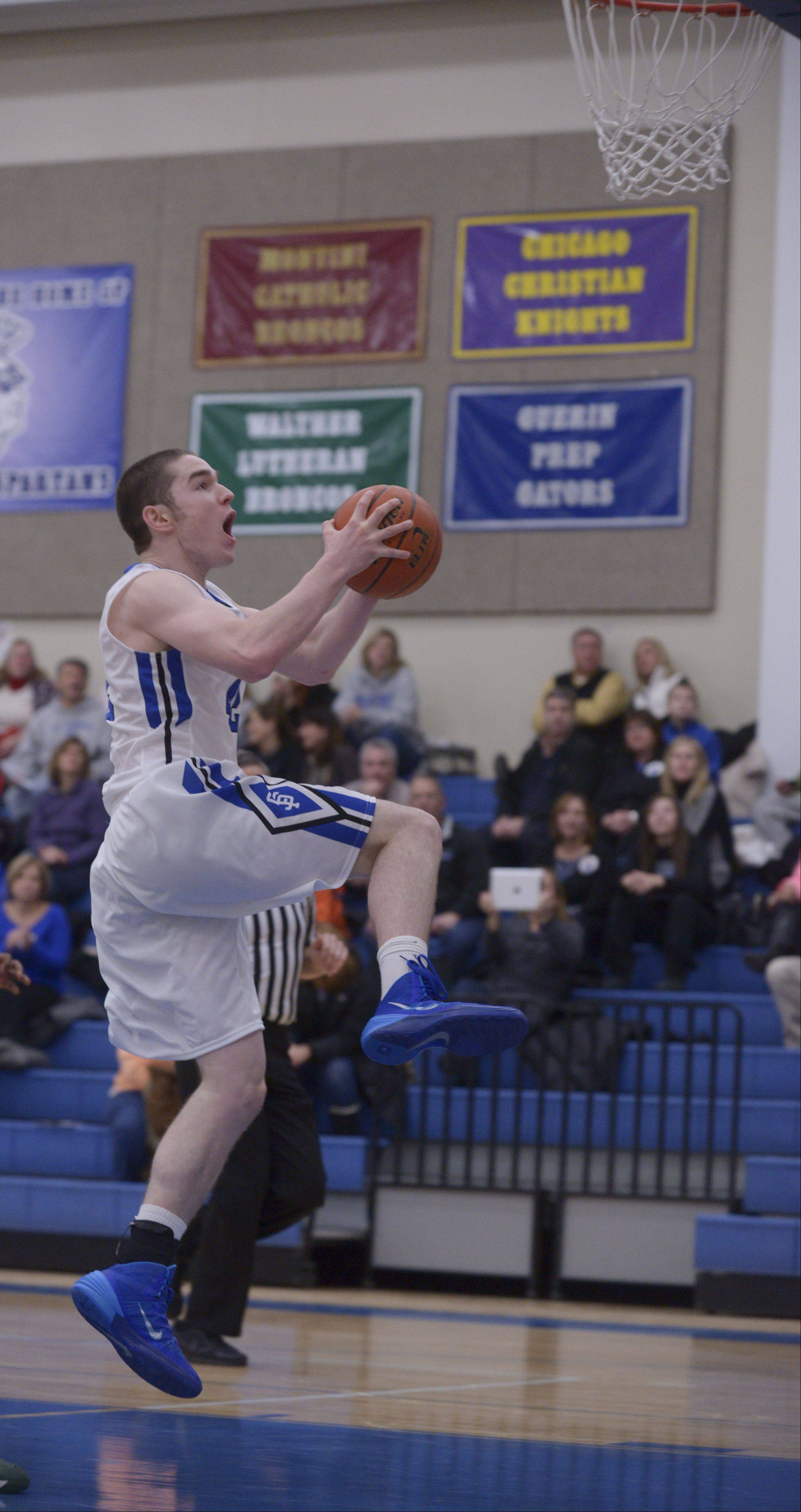 St. Francis' Kilian Brown drives to the basket against Walther Christian Academy at home in boys basketball.