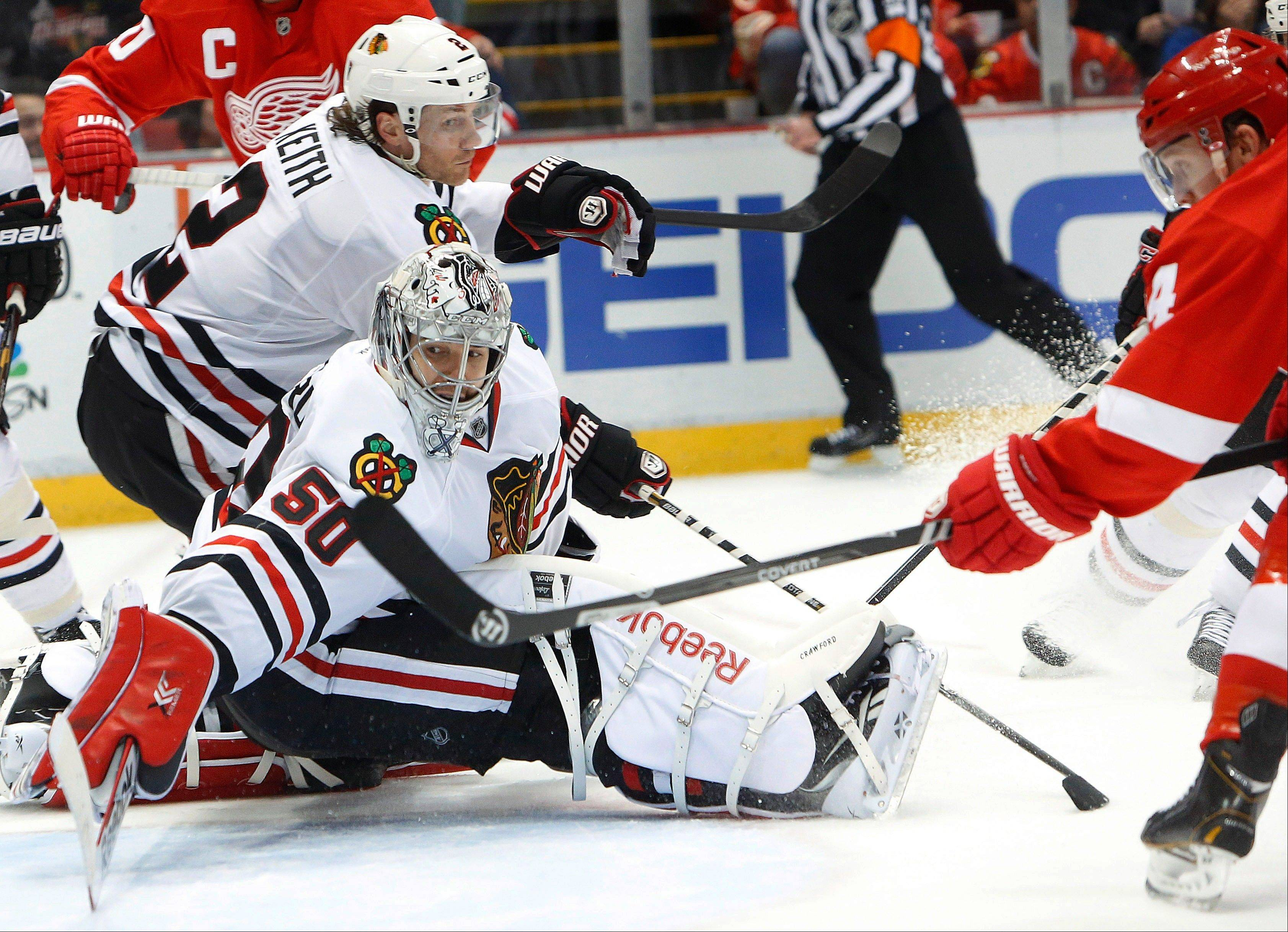 Red Wings center Gustav Nyquist, right, scores Blackhawks goalie Corey Crawford in the second period Wednesday day.