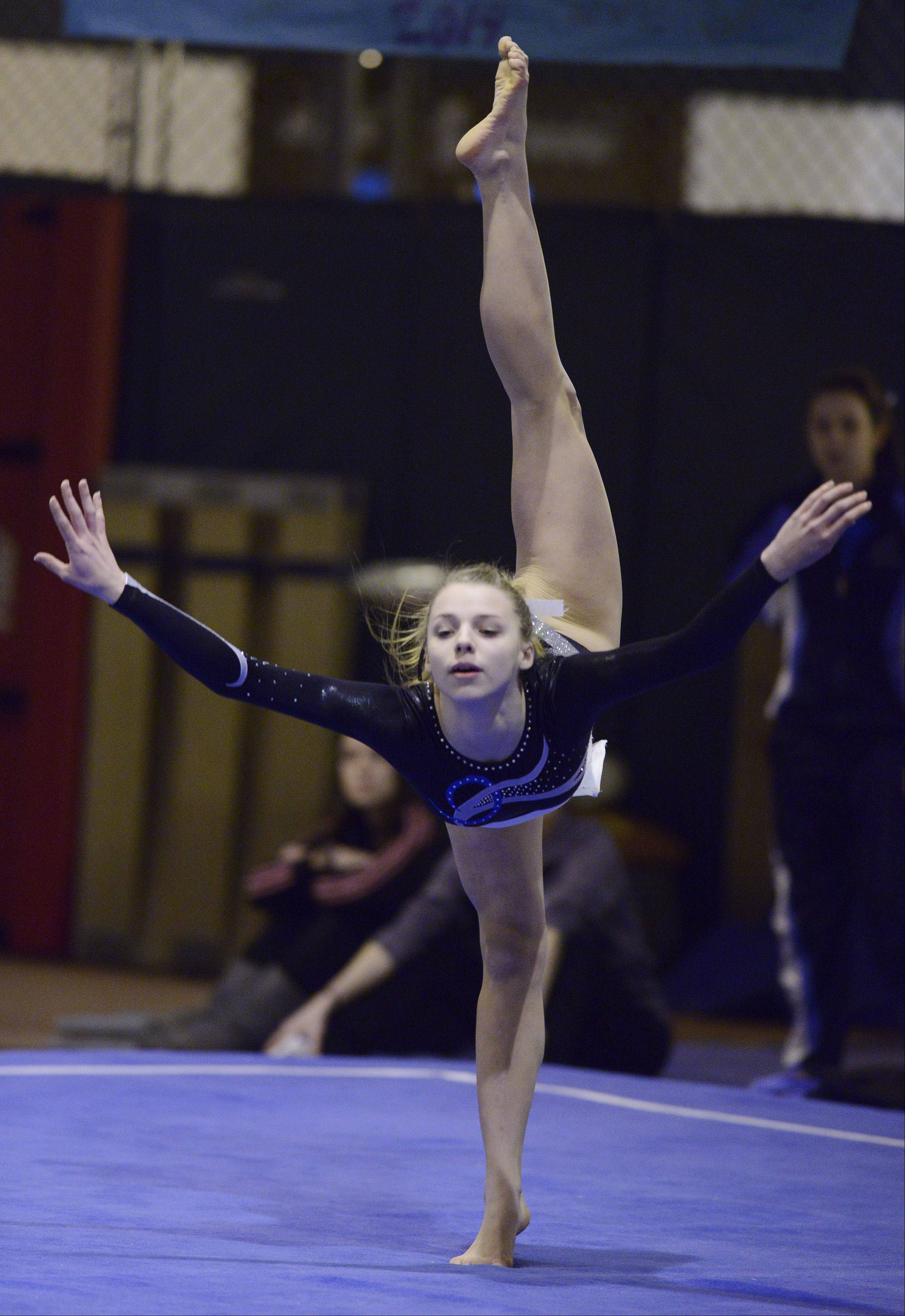 Prospect�s Olivia Gonzalez competes on the floor exercise during Wednesday�s meet with Buffalo Grove and host Elk Grove.