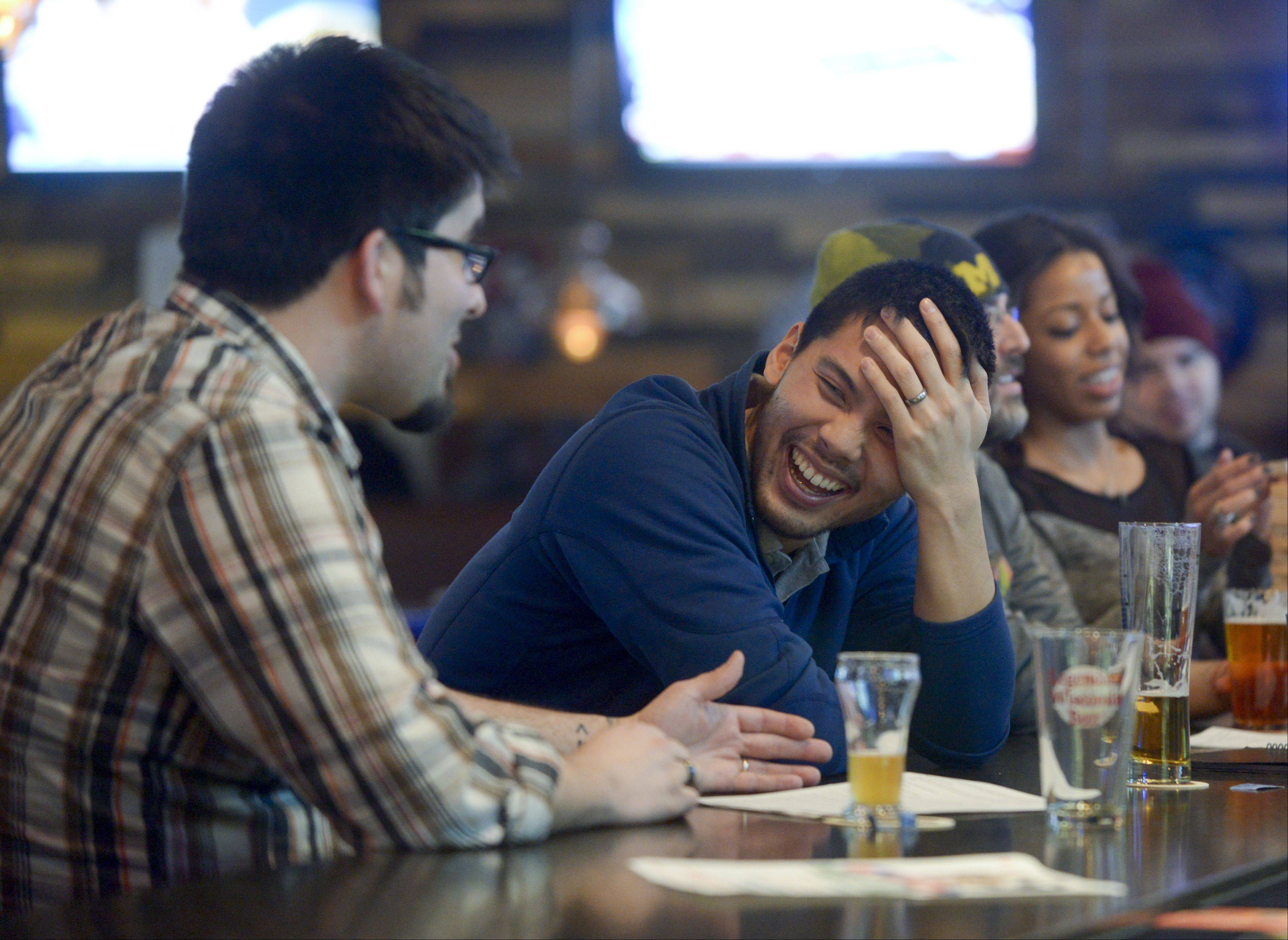 Josh Riley of Lombard and Derek Chan of Oak Brook enjoy a few laughs at Lombard's Beer House.