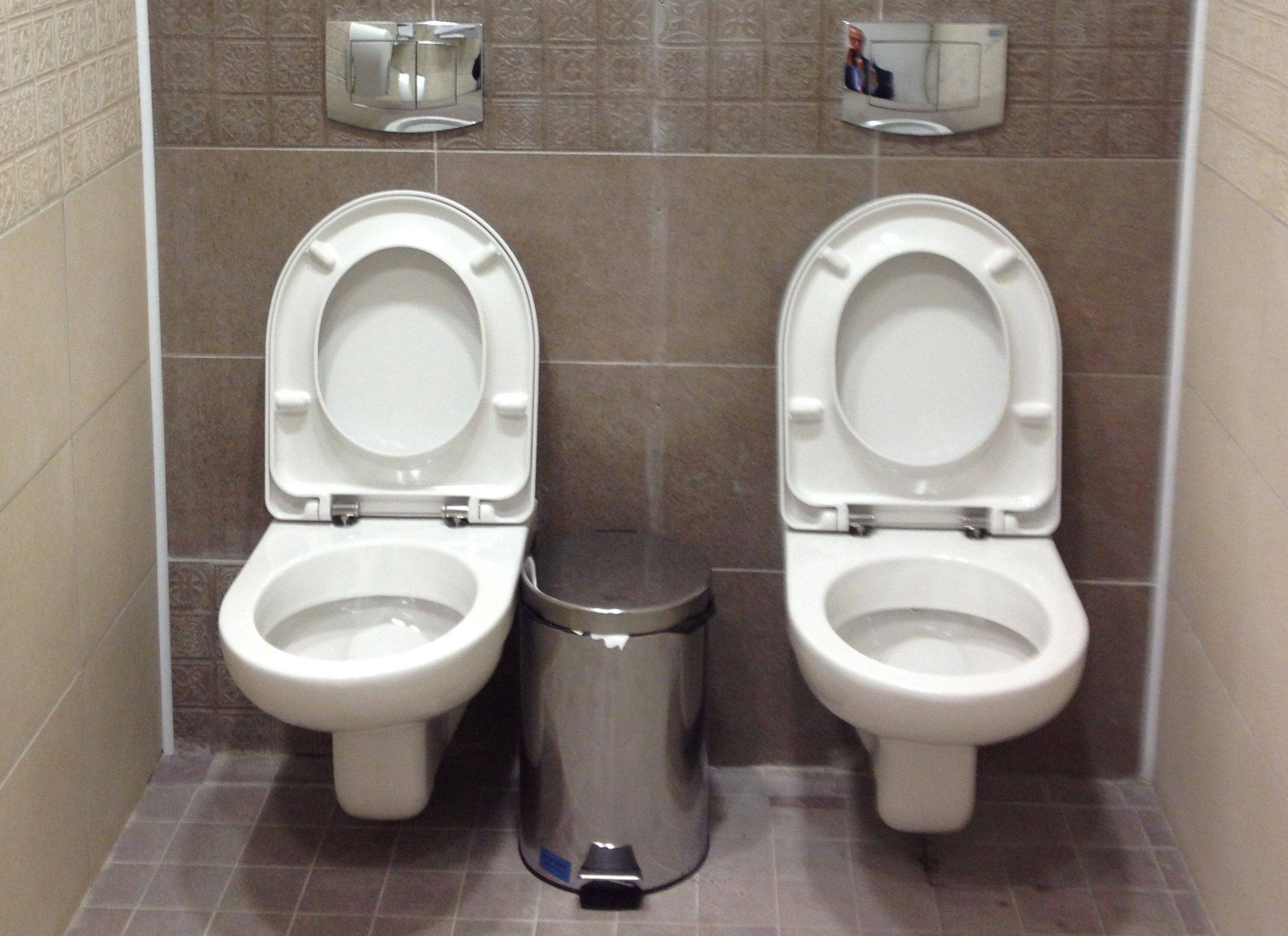 Westerners may be surprised at just how cozy Russians can get. These are toilets at the cross-country skiing and biathlon center for the Sochi Olympics.