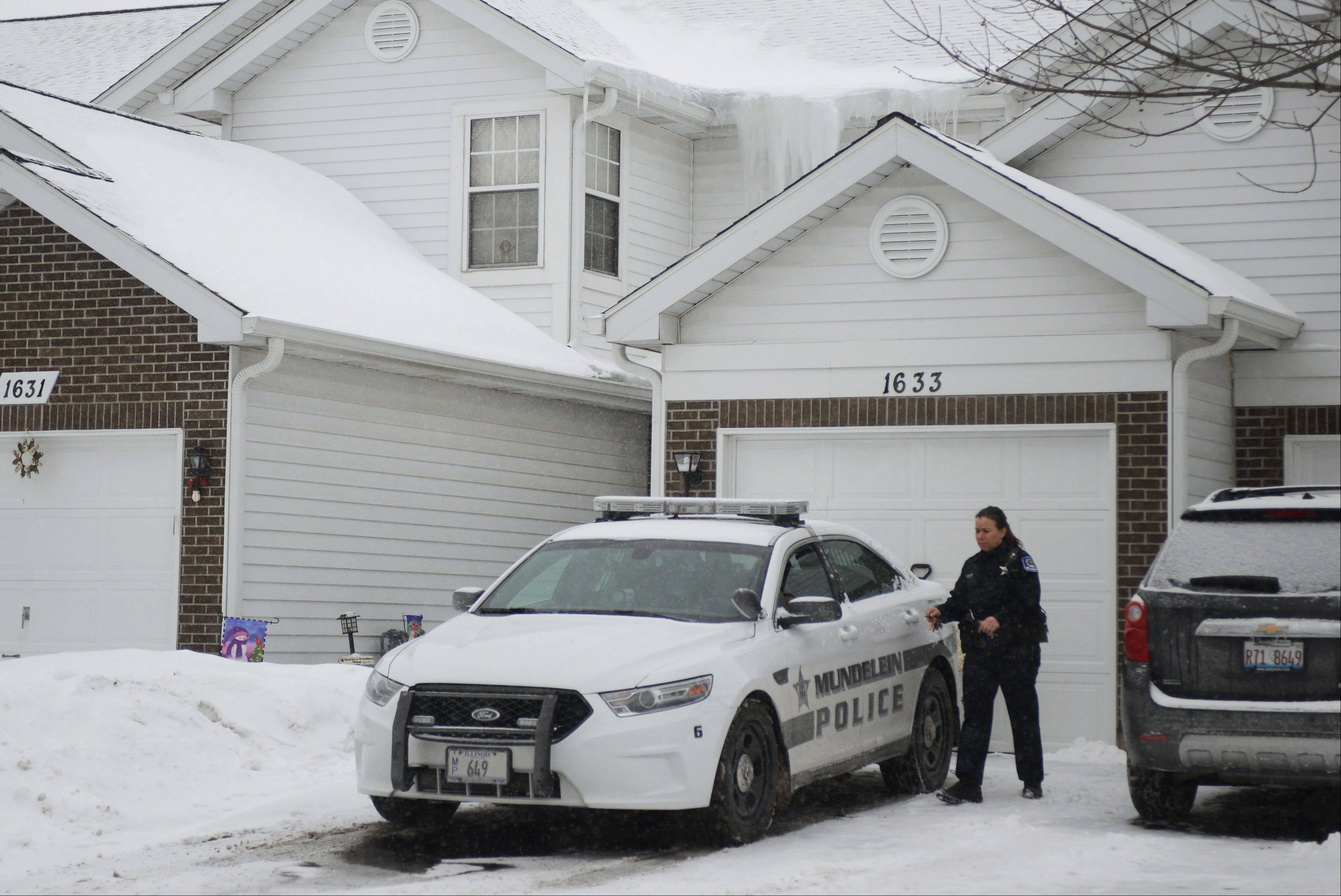Mundelein police remain at the Mundelein home on Wednesday where an 11-year-old girl was killed Tuesday. The victim's 14-year-old half-sister faces first-degree murder charges, authorities said.